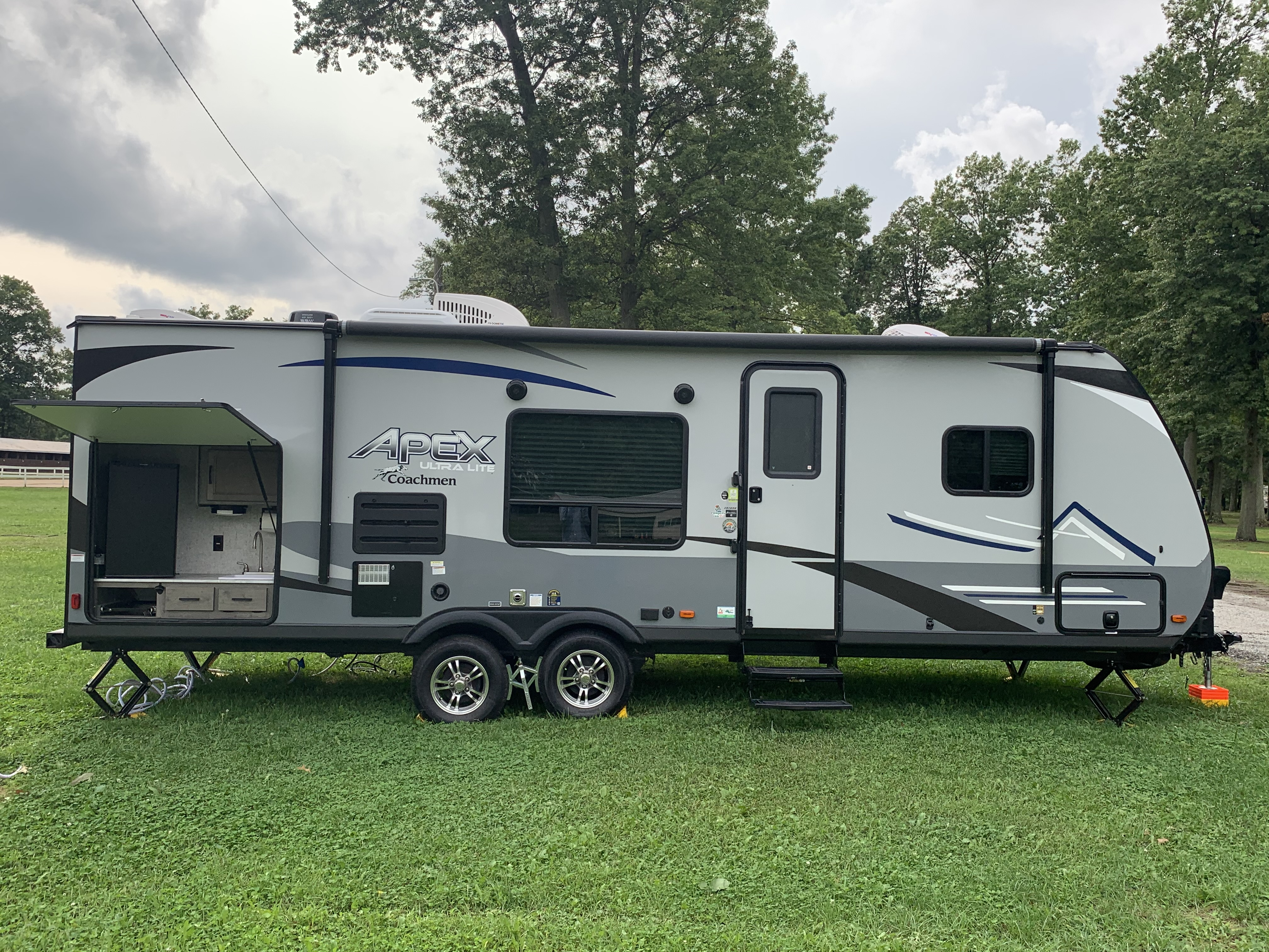 Great outside kitchen w/fridge, sink, and grill. Large power awning. Coachmen Apex 2021
