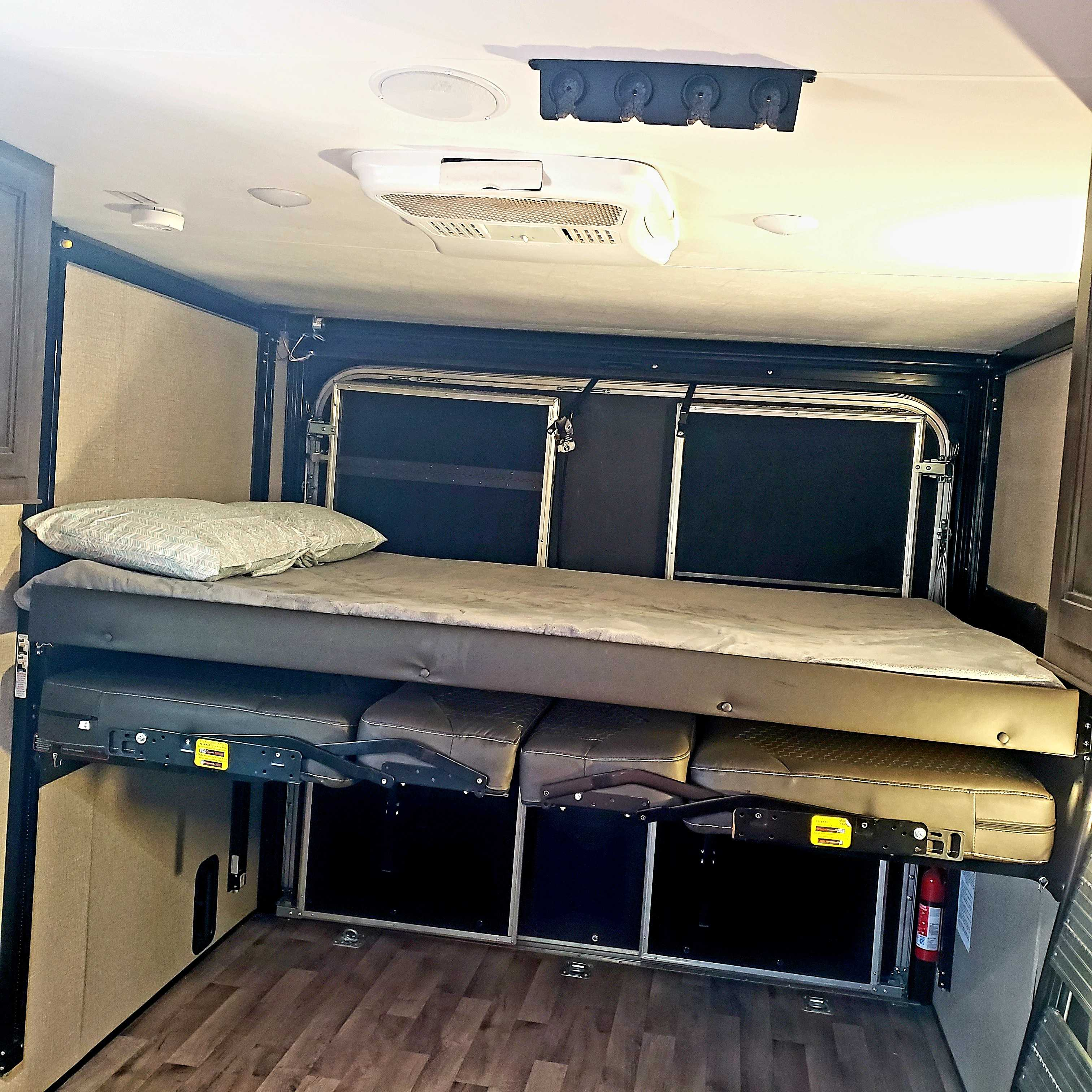 2nd and 3rd beds in the cargo area can be raised and lowered at the push of a button. . Jayco Octane 2020