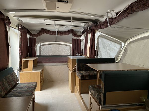 Plenty of room to walk around with the Dinette sliding out. Dinette also converts into a bed if you need the extra sleeping space.. Coleman Grand Tour Niagara 1999