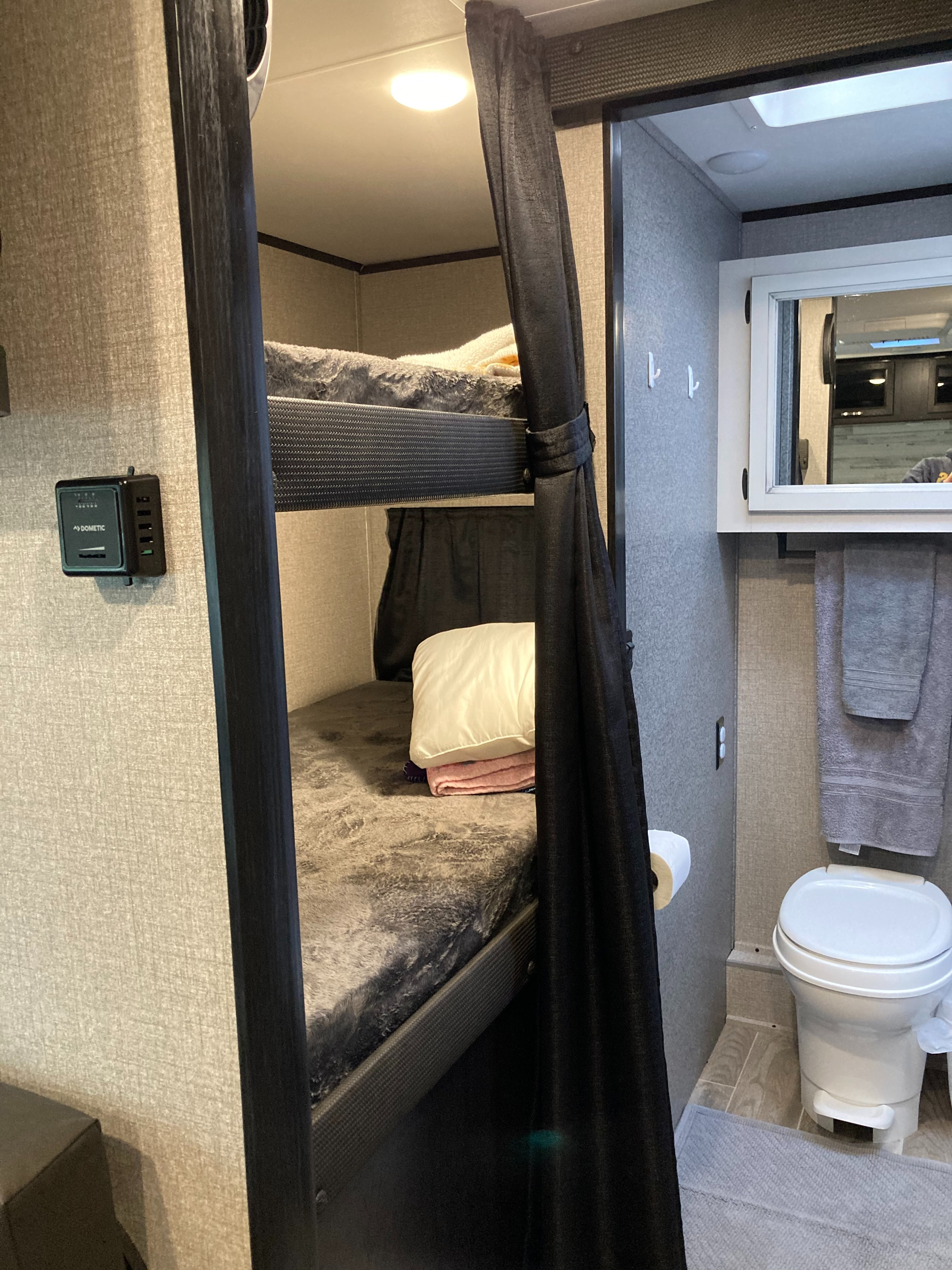 Twin bunks (each has window, outlet, and small shelf). Jayco Jay Feather 2021
