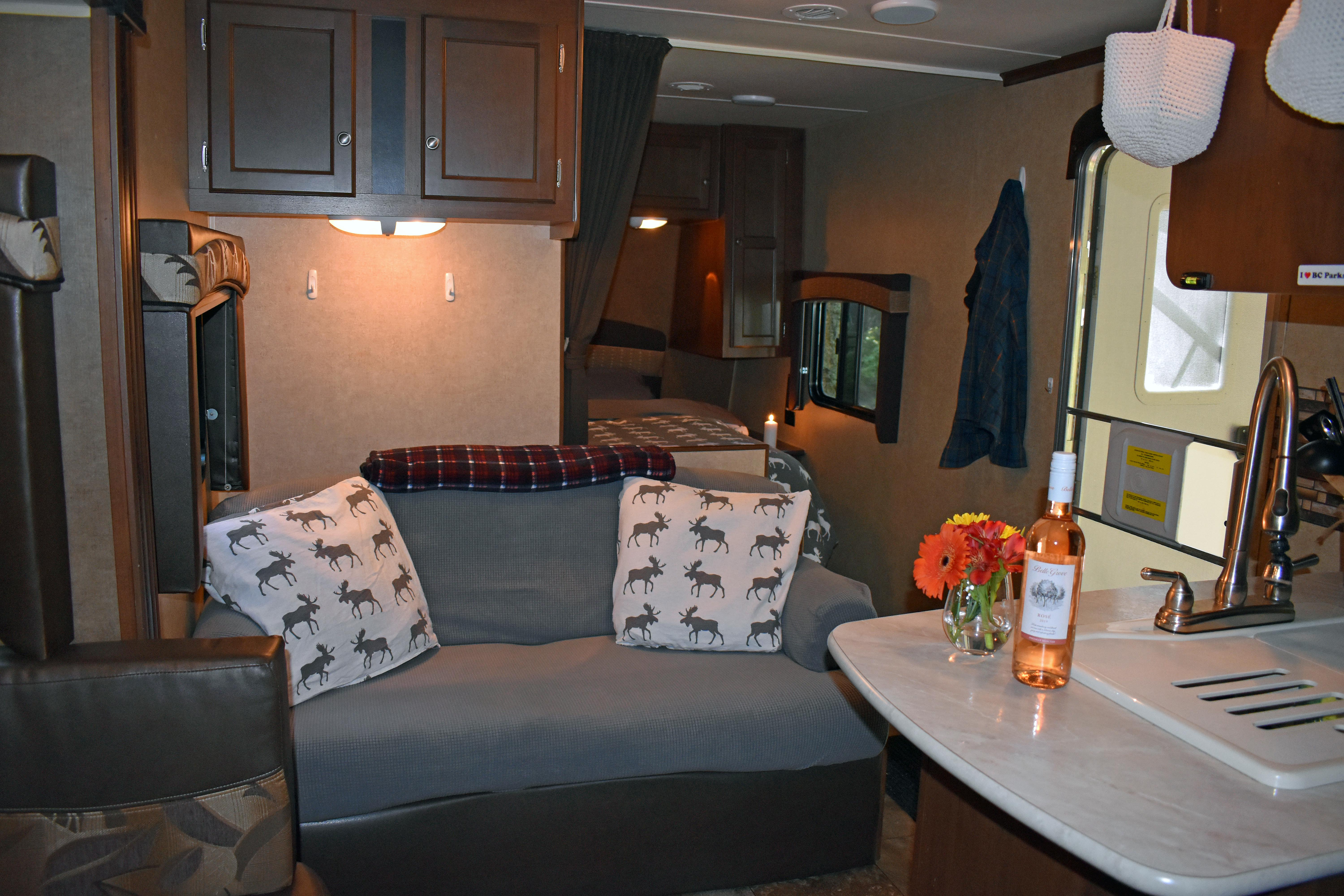 Couch (fold down bed) for lounging and opposite the media centre. Jayco Jay Flight 2014