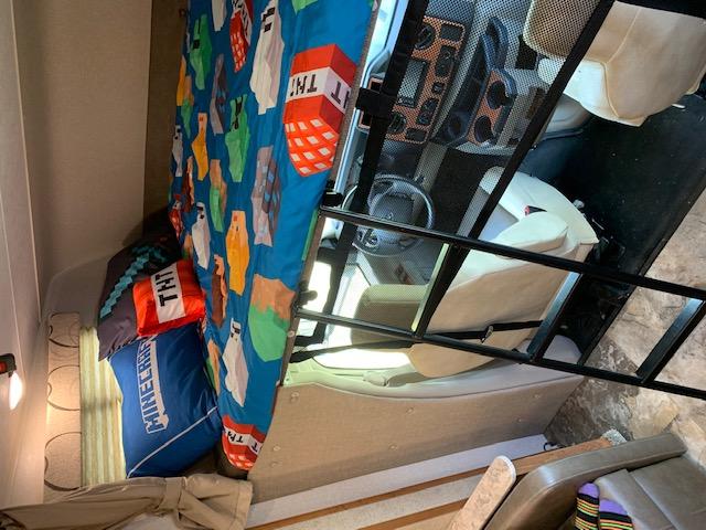 Over-cab bunk with Minecraft theme.... Coachmen Leprechaun 2019