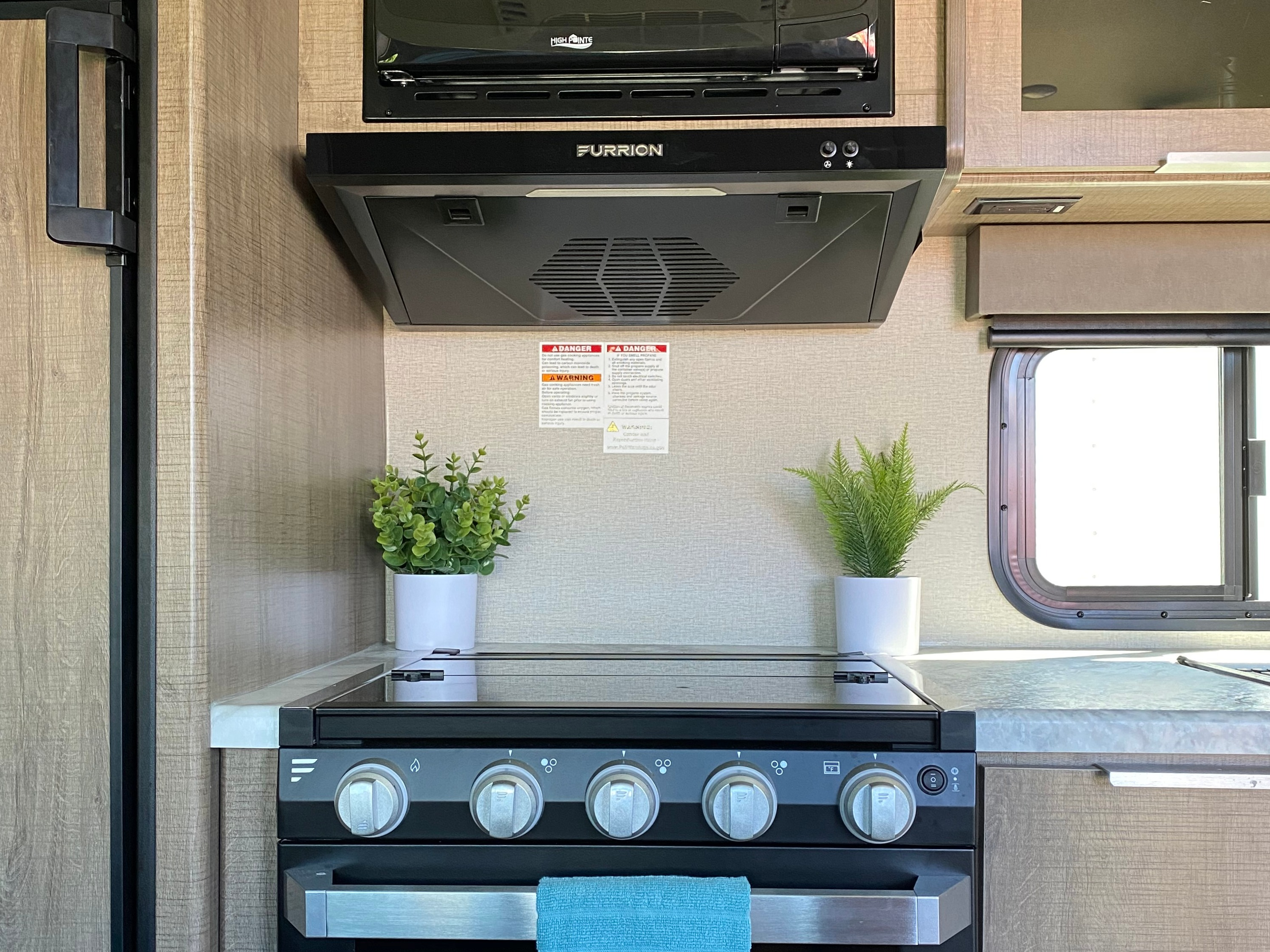 Buzz has all the major (RV size) appliances in the kitchen! Microwave, stove, oven and refrigerator with freezer.. Grand Design Other 2021