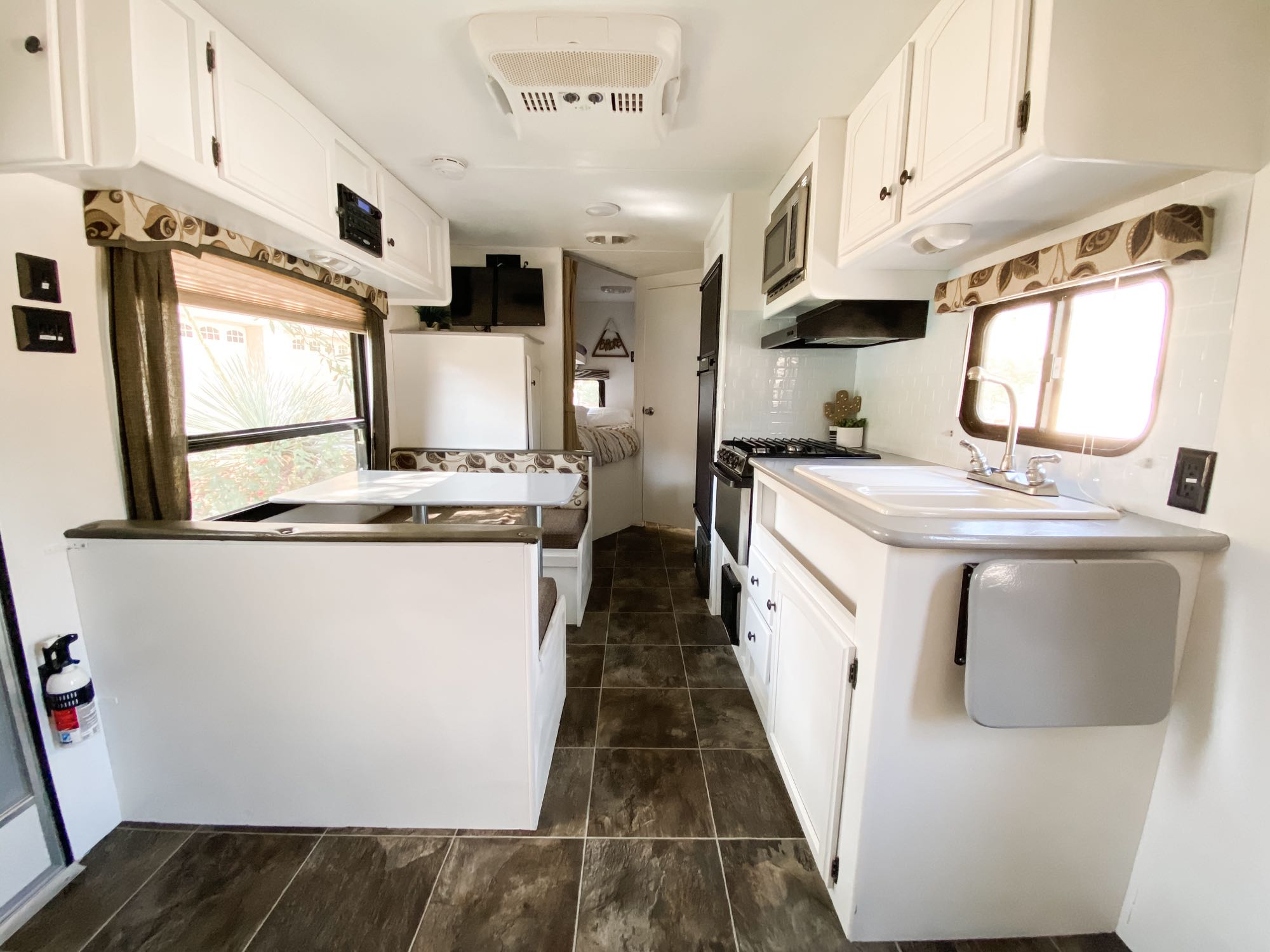 Fully equipped kitchen with double sink, microwave, stove, oven, and refrigerator.. Keystone Hideout 2014