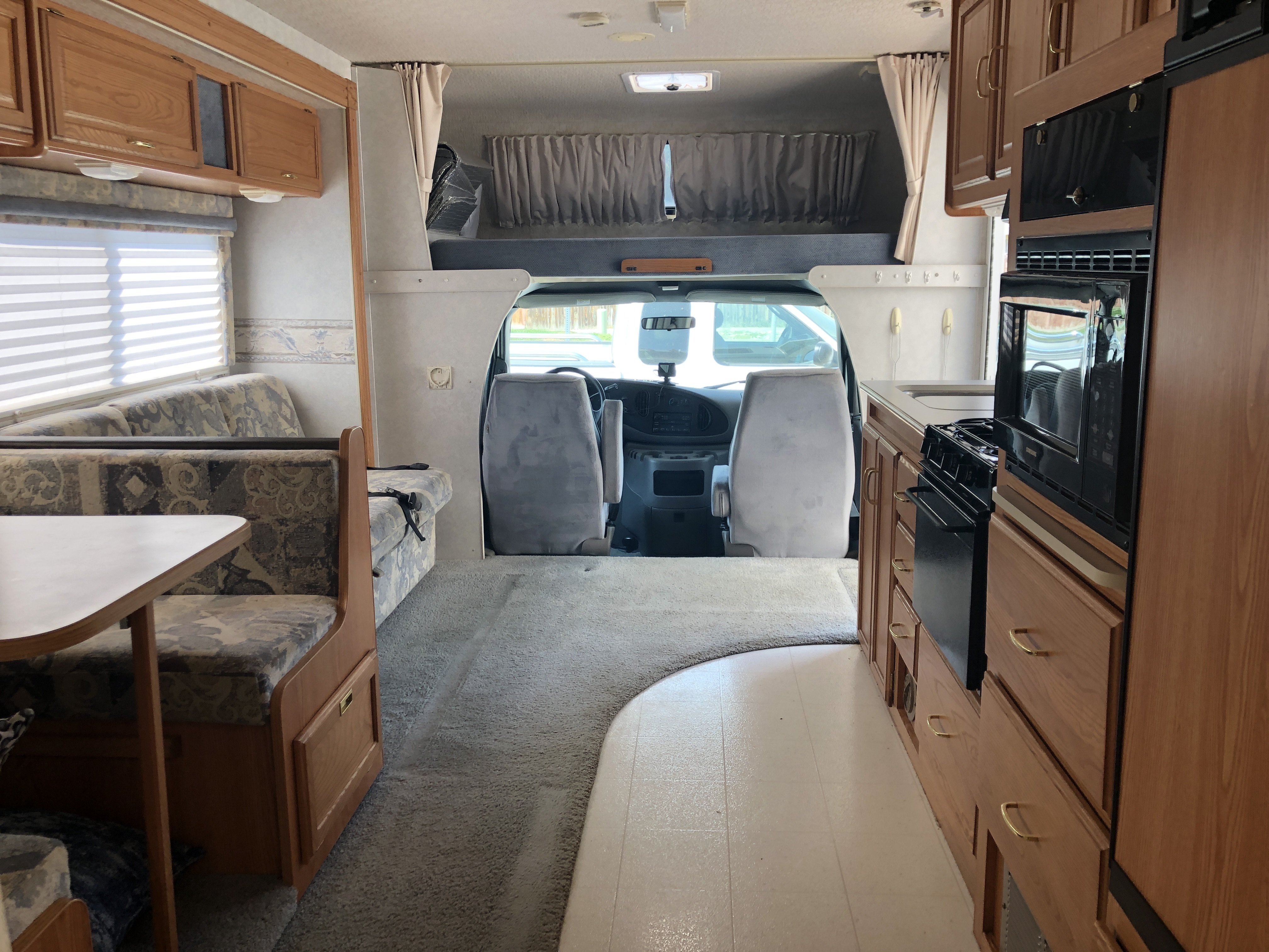 Extra space with the slide extended pushing out the couch and dinette. Winnebago Minnie Winnie 2000