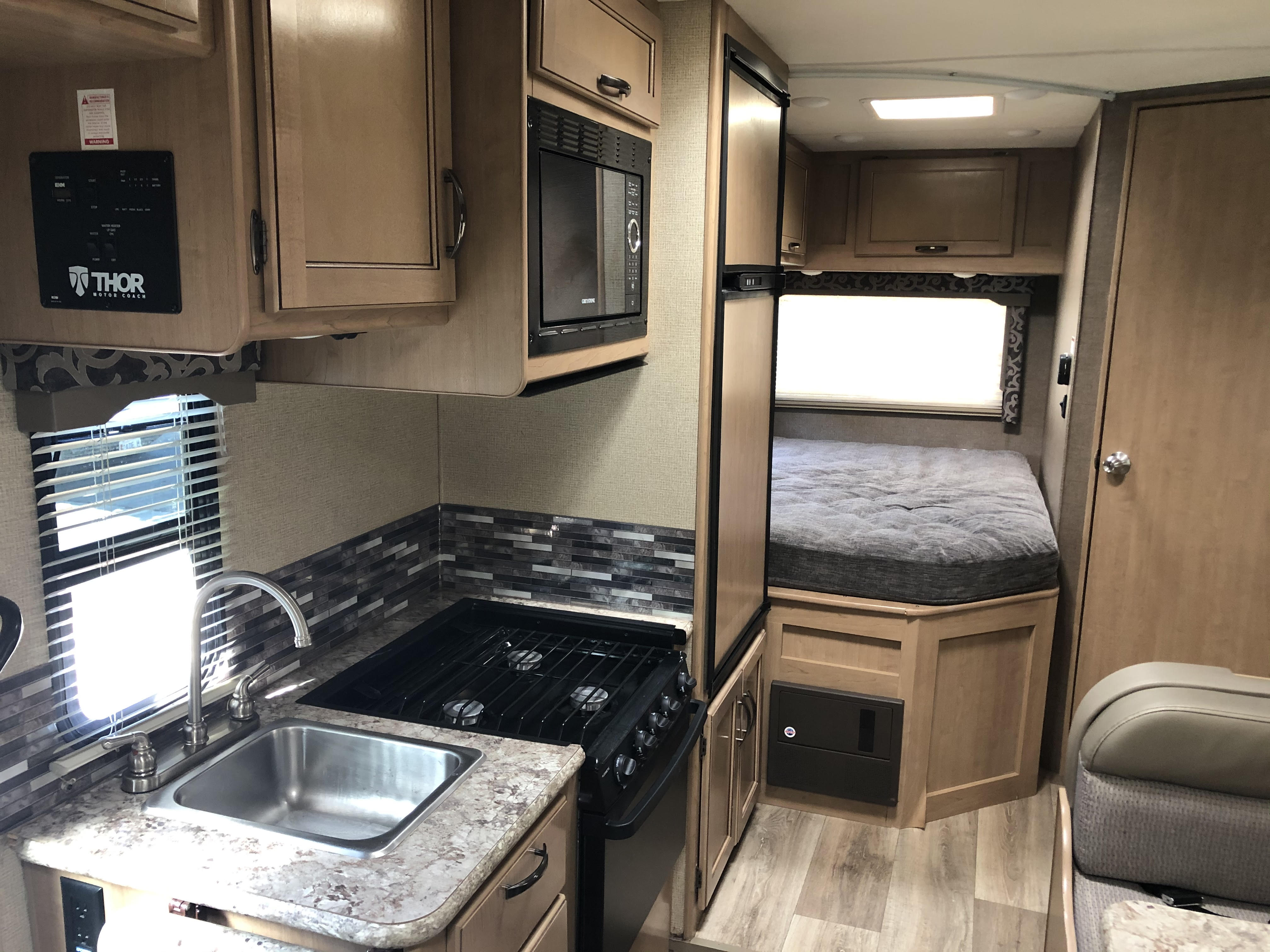 Includes 3 burner stove, oven, microwave and refrigerator. Generator on board to power all appliances.. Thor Motor Coach Four Winds 2019