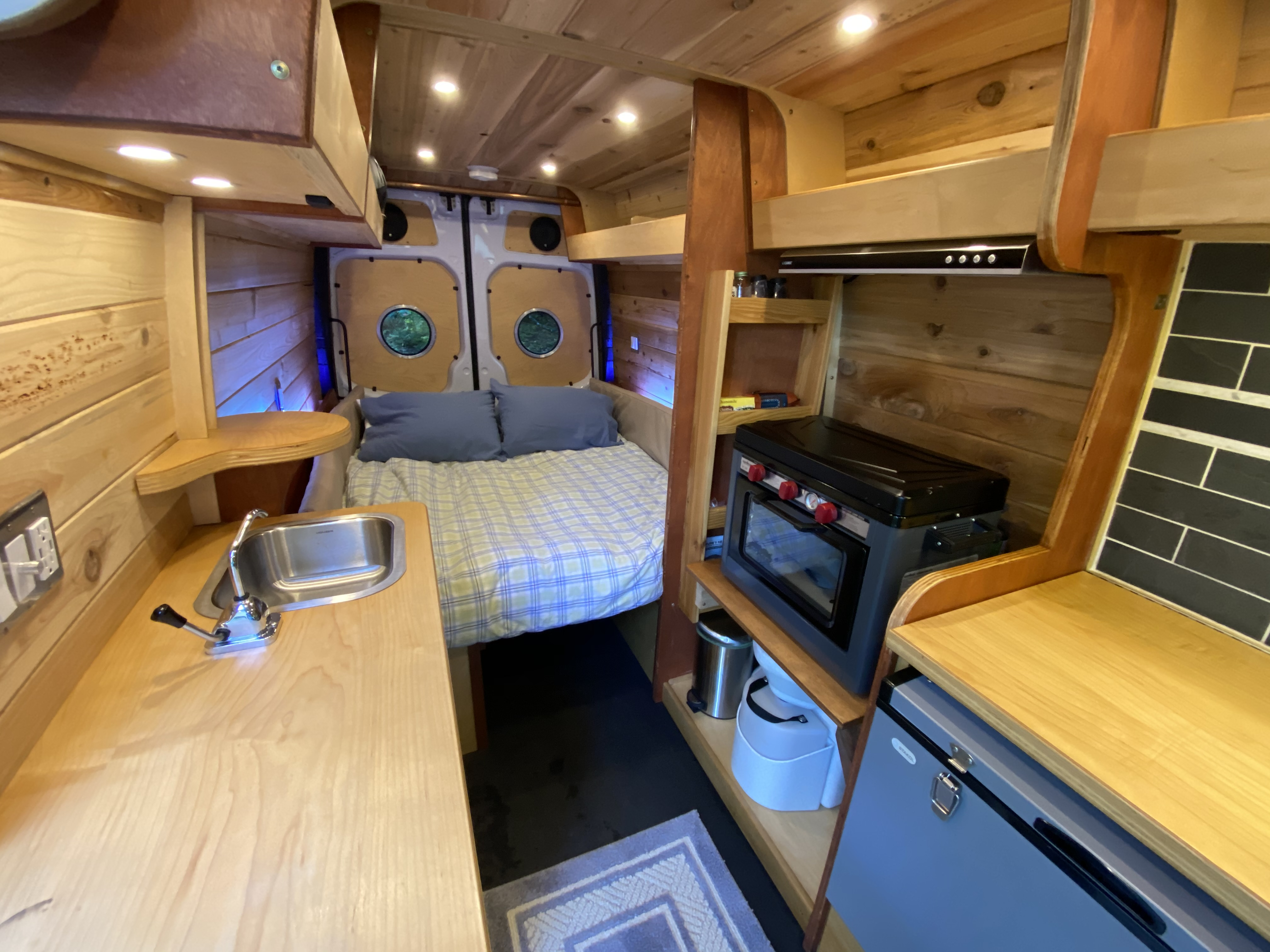 Sleeping space for two (short queen) converts into dining space for four with ease. Mercedes-Benz Sprinter 2008