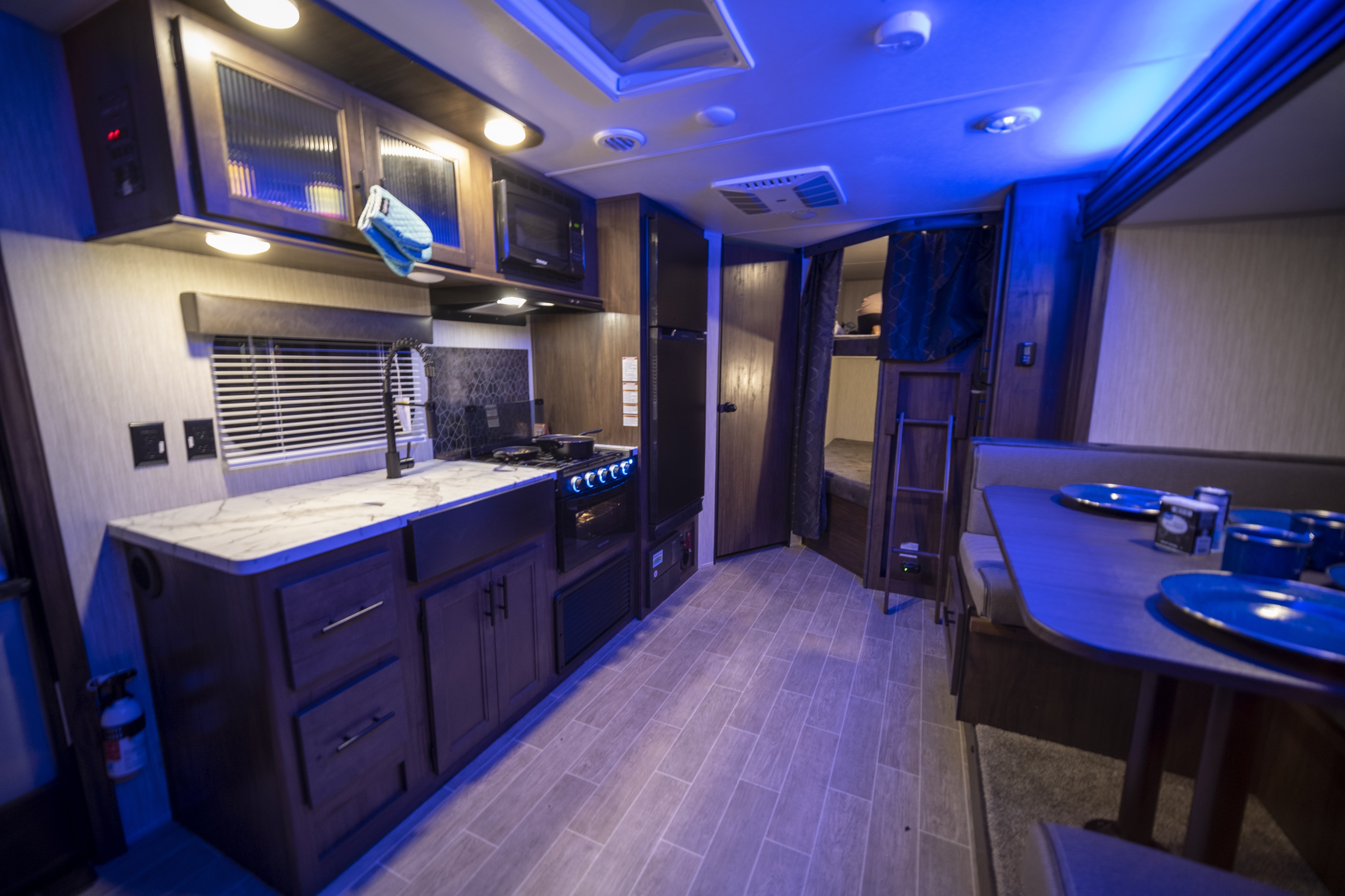 kitchen and bunk area. Forest River Cherokee Grey Wolf 2021