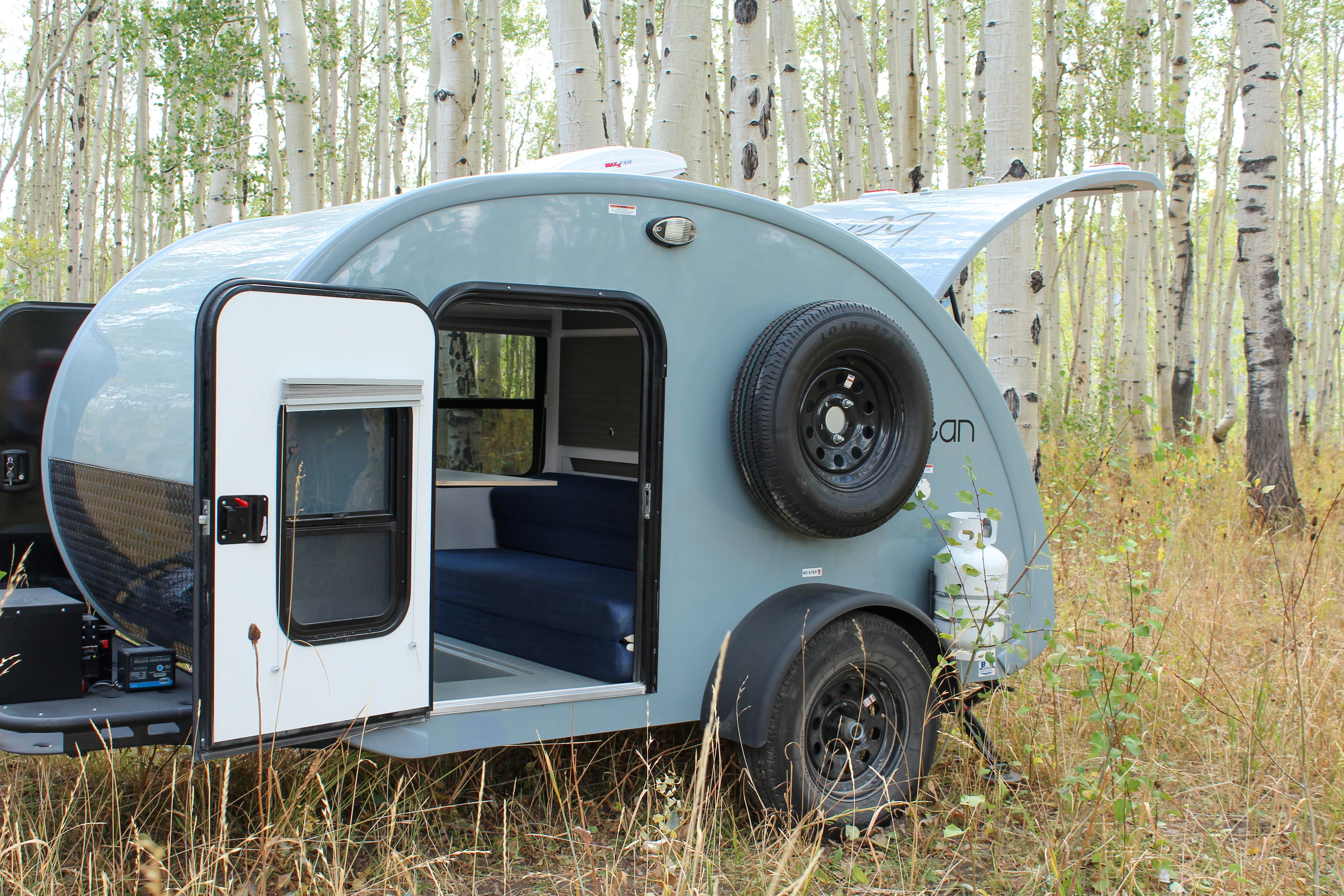 Exterior Door, Spare Tire, Propane tank. Bean Trailer Bean Stock 2020