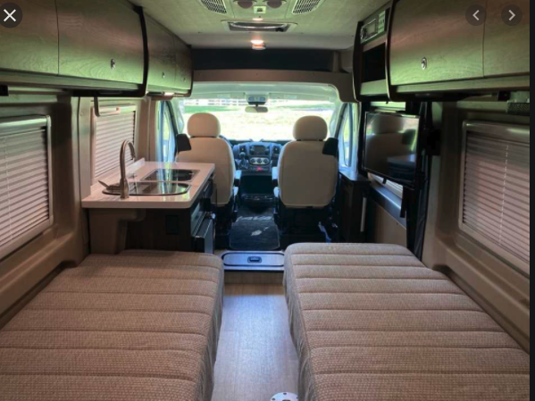 Two beds, can be made into one full size also.. Winnebago Travato 2019