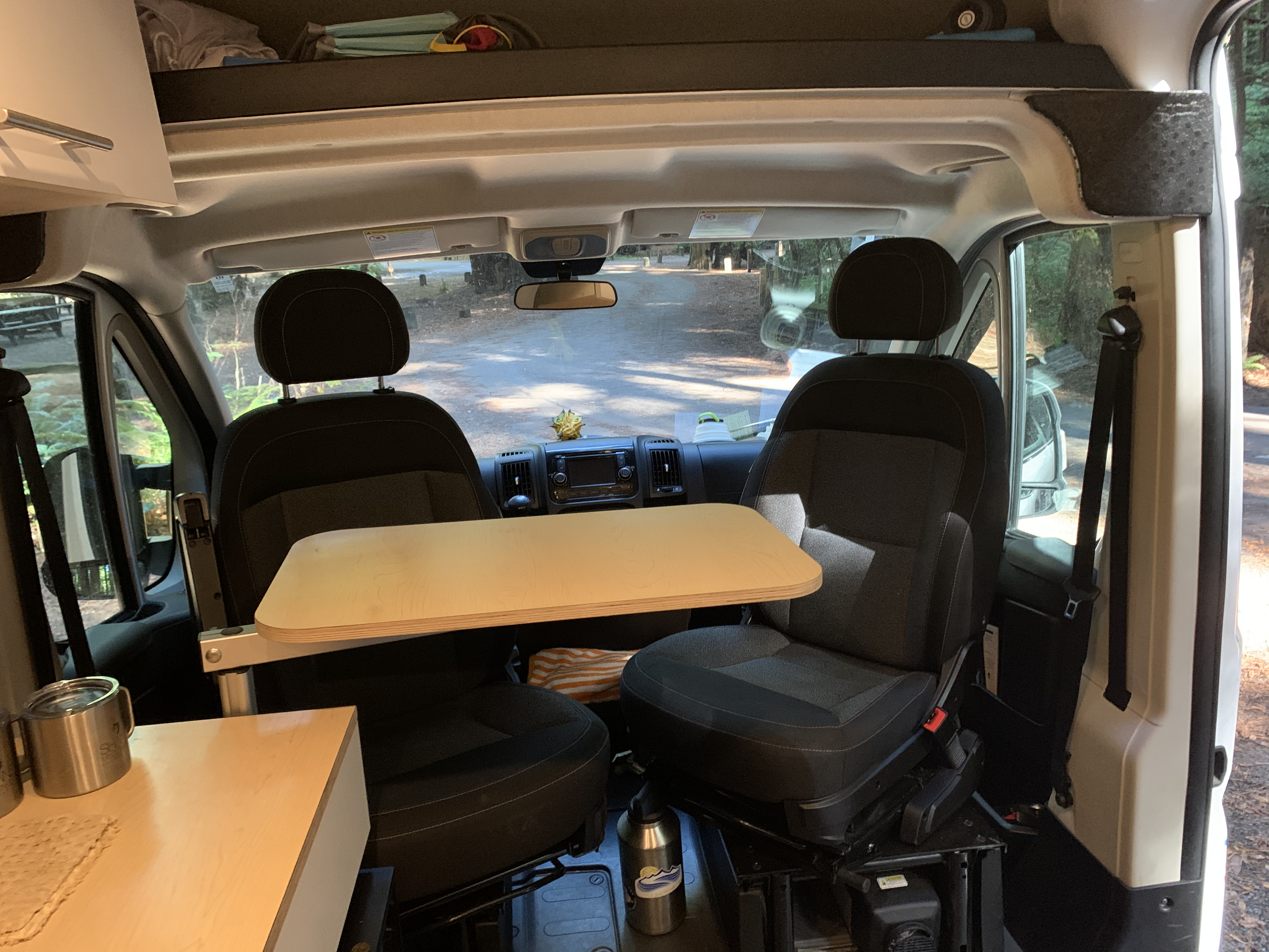 Swivel table is great for dining, extra counter space, or remote working. Captains chairs spin for in-van dining.. Ram Promaster 1500 2017