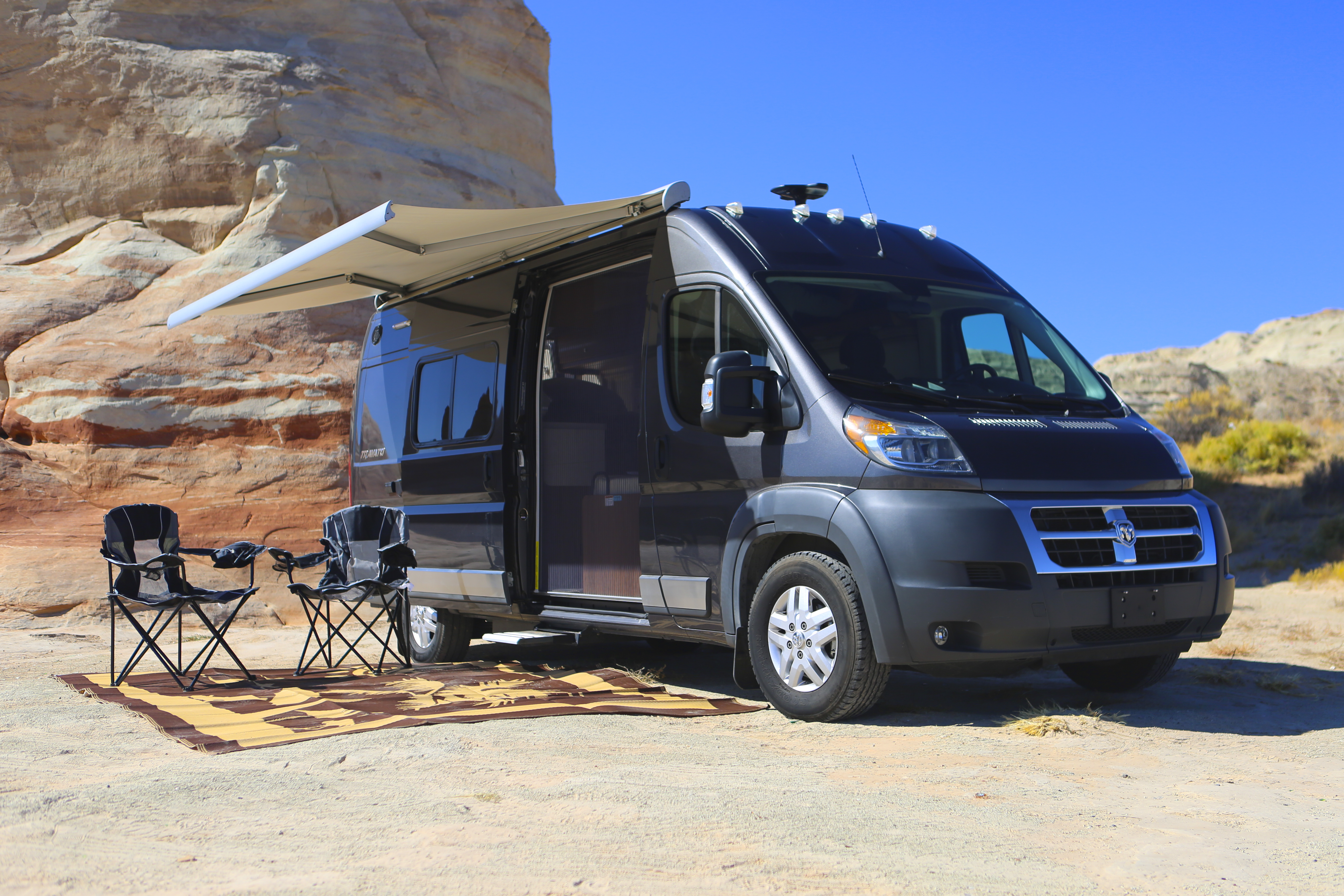 Set up an impromptu camp site in less than a minute with the fully motorized awning and footstep.. Winnebago Travato 2018
