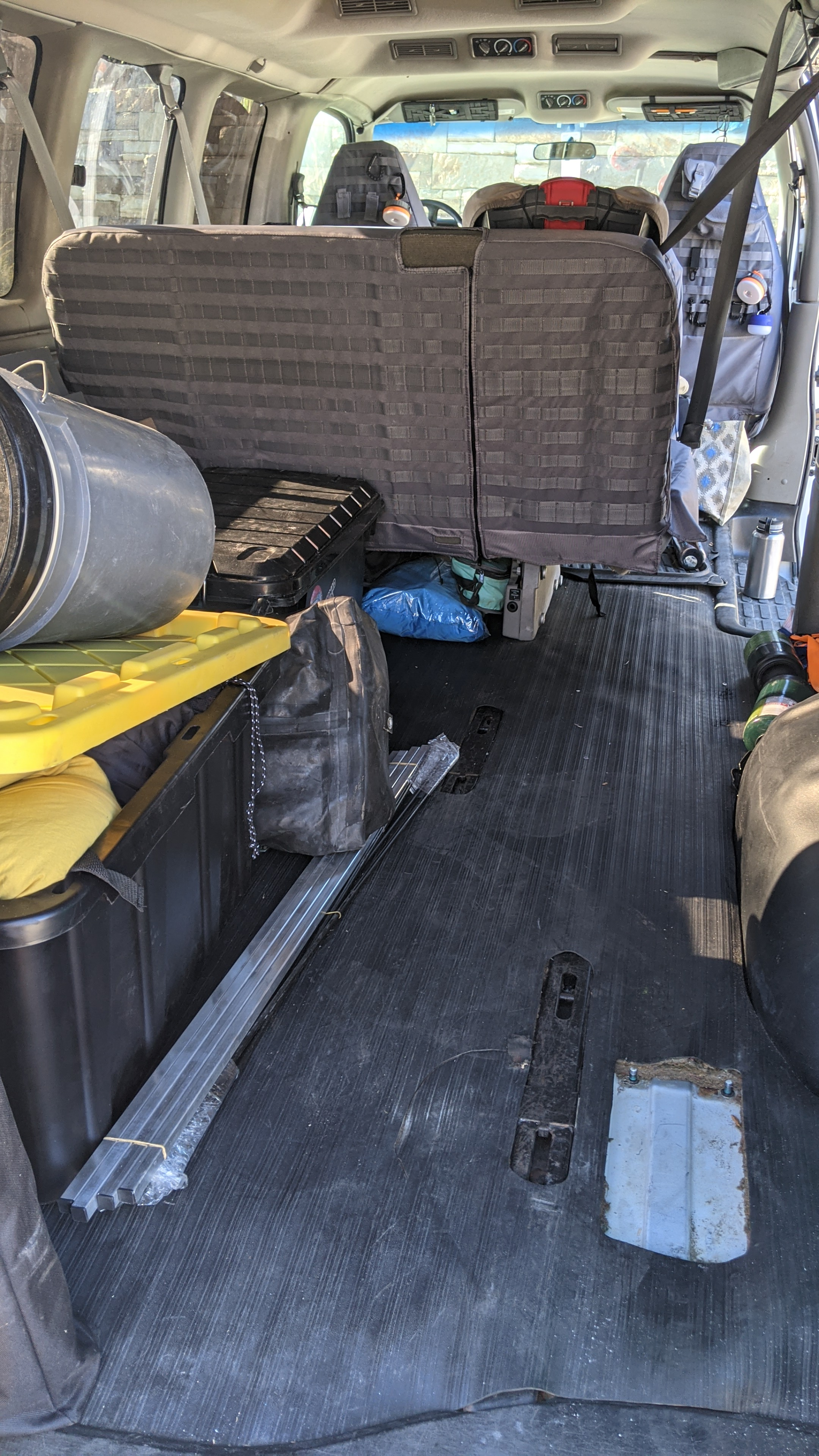 Large storage area behind seat with optional/moveable bed platform. Gmc Savanna 2001