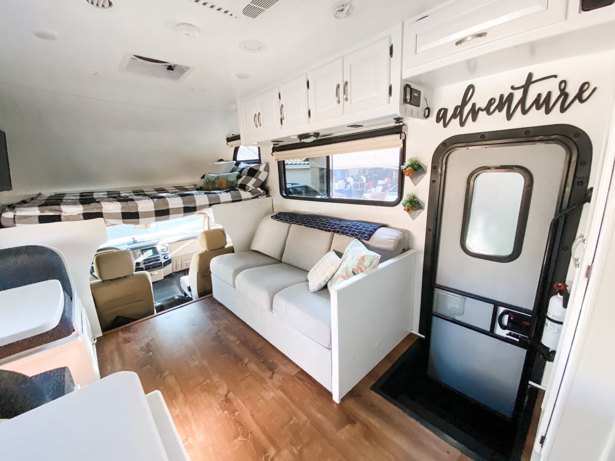 Sofa with storage compartments under cushions. Thor Motor Coach Four Winds 2016