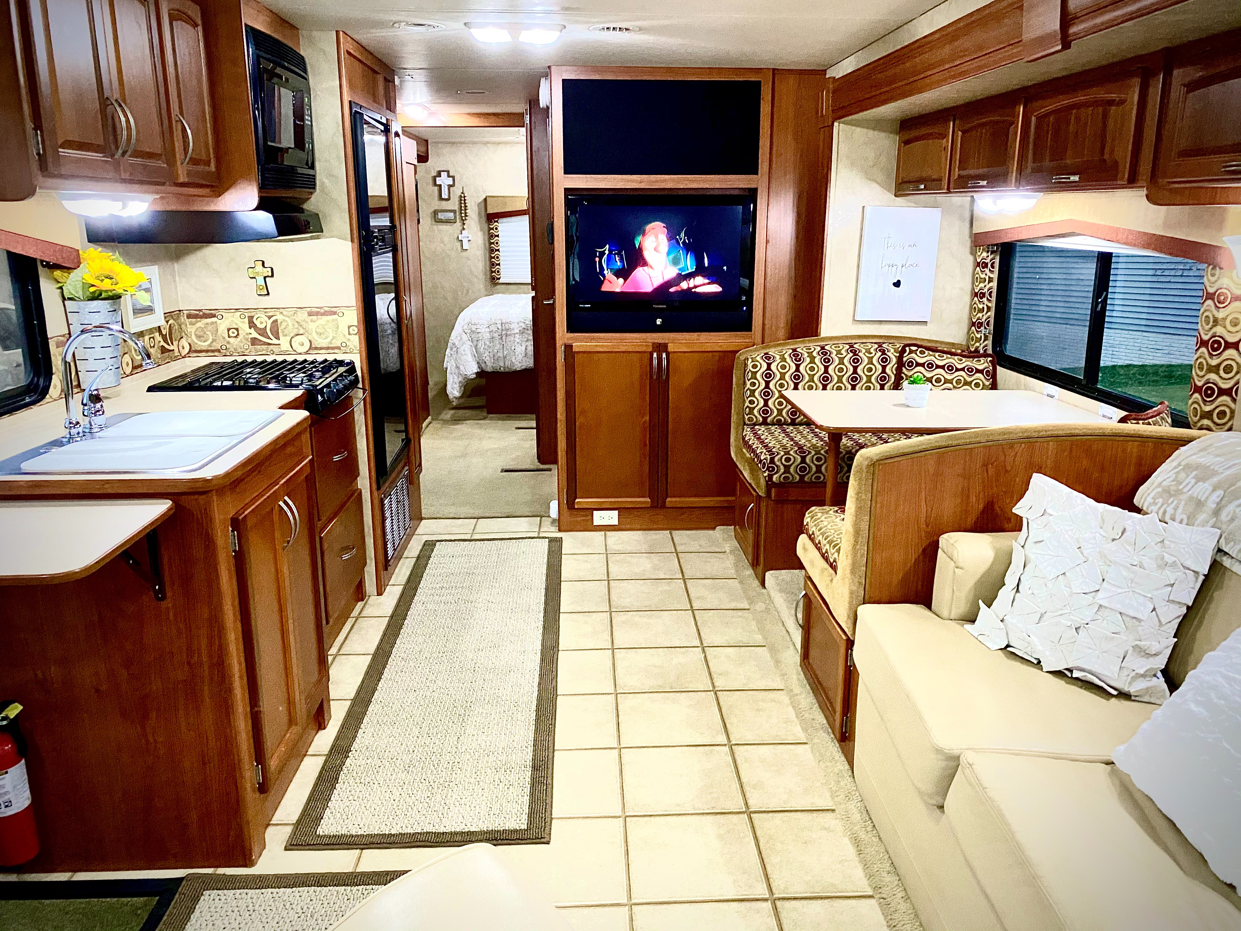 Open area with queen pullout couch and table that converts to bed  . Holiday Rambler Arista 2010