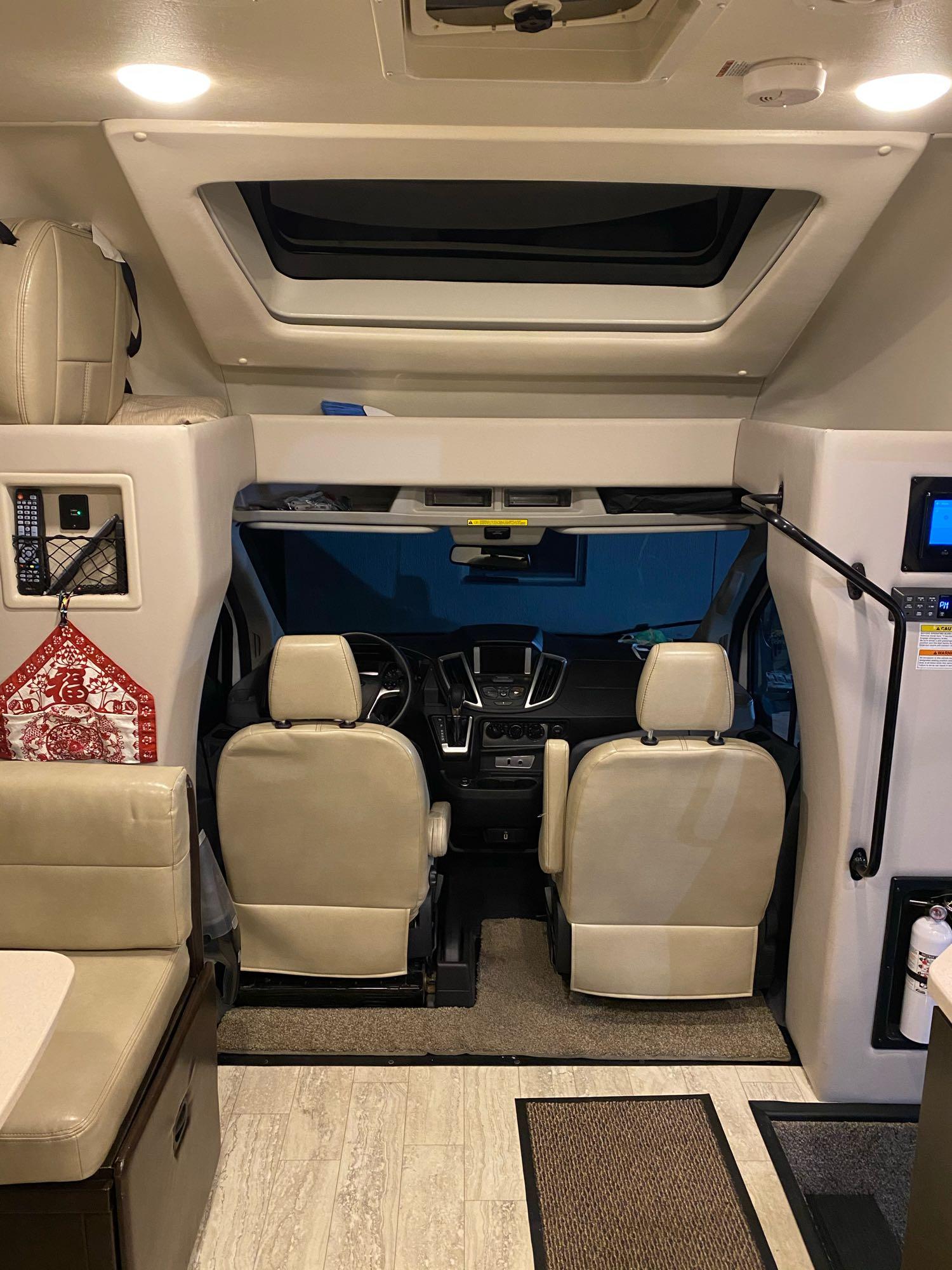 Passenger seat swivel to face living area. . Thor Motor Coach Gemini 23TK 2019