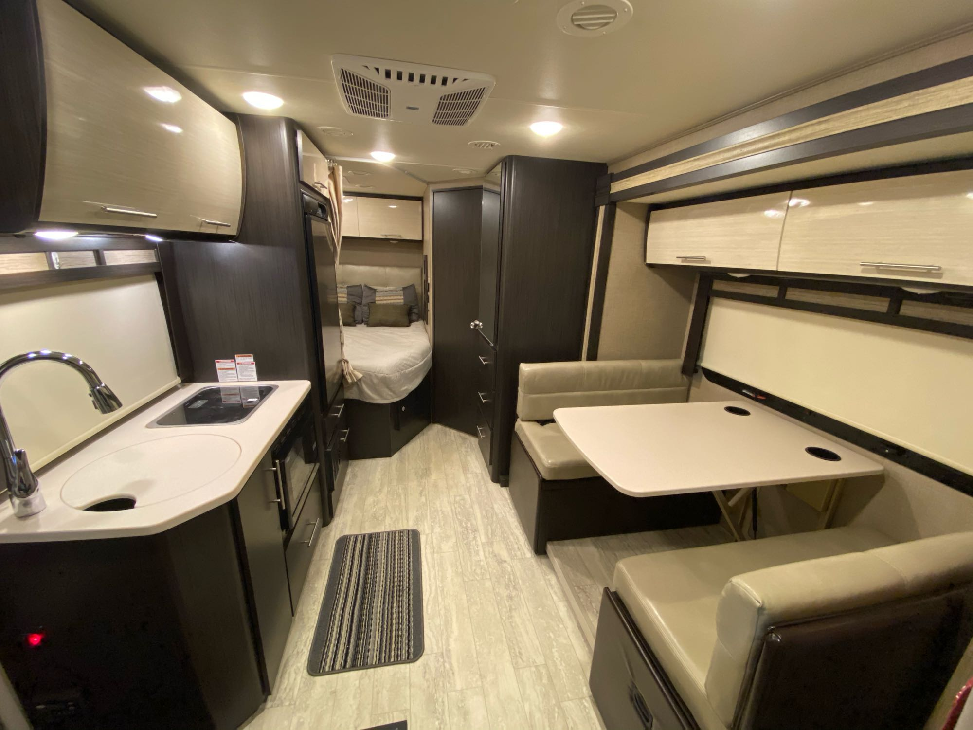 Kitchen is accessible even with slide out in position. . Thor Motor Coach Gemini 23TK 2019