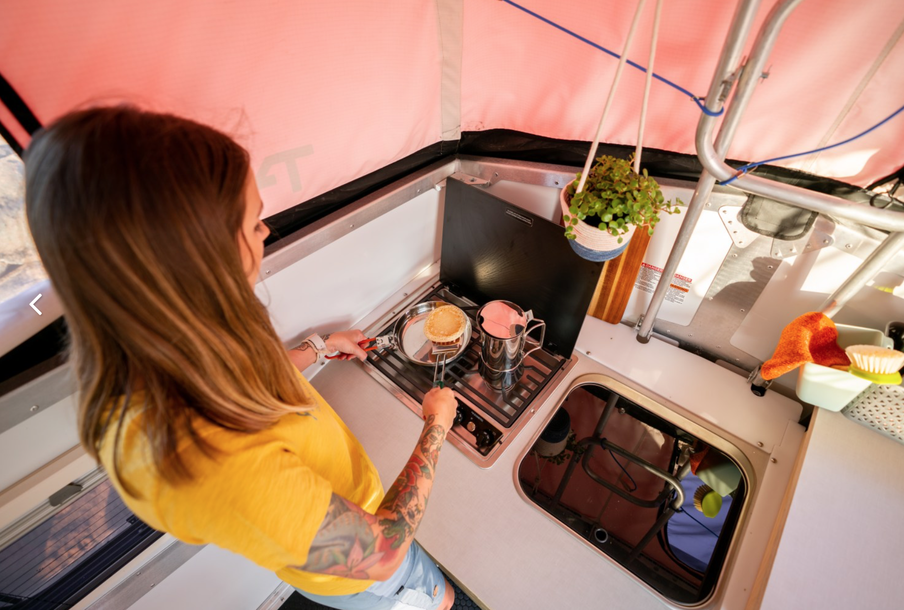 Here's a nice photo of the kitchen area. Some folks bring plants in to blend the lines between outdoor and in.. TAXA Outdoors Cricket Camper 2021
