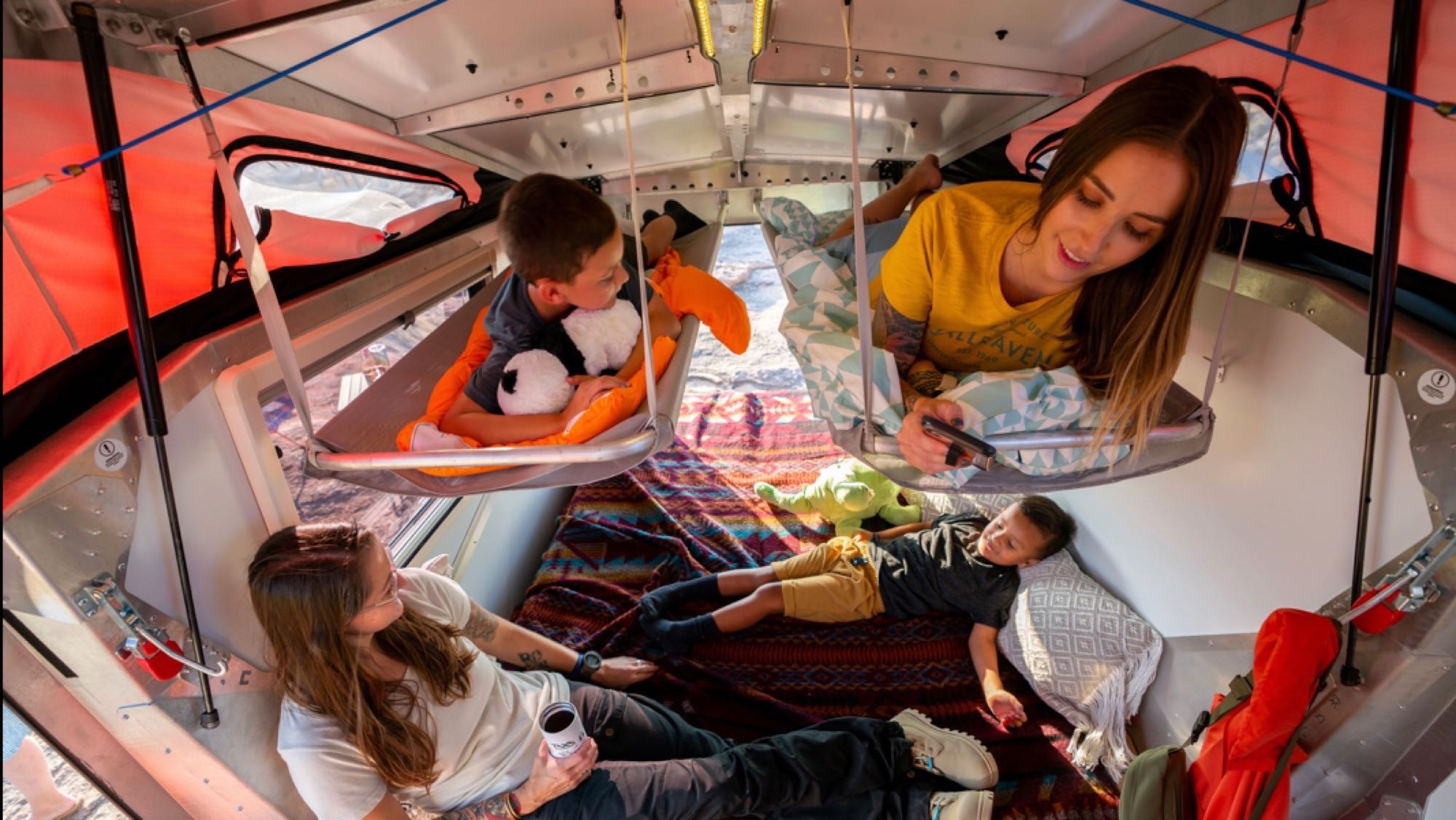 stock photo from website showing the sleeping setup. TAXA Outdoors Cricket Camper 2021