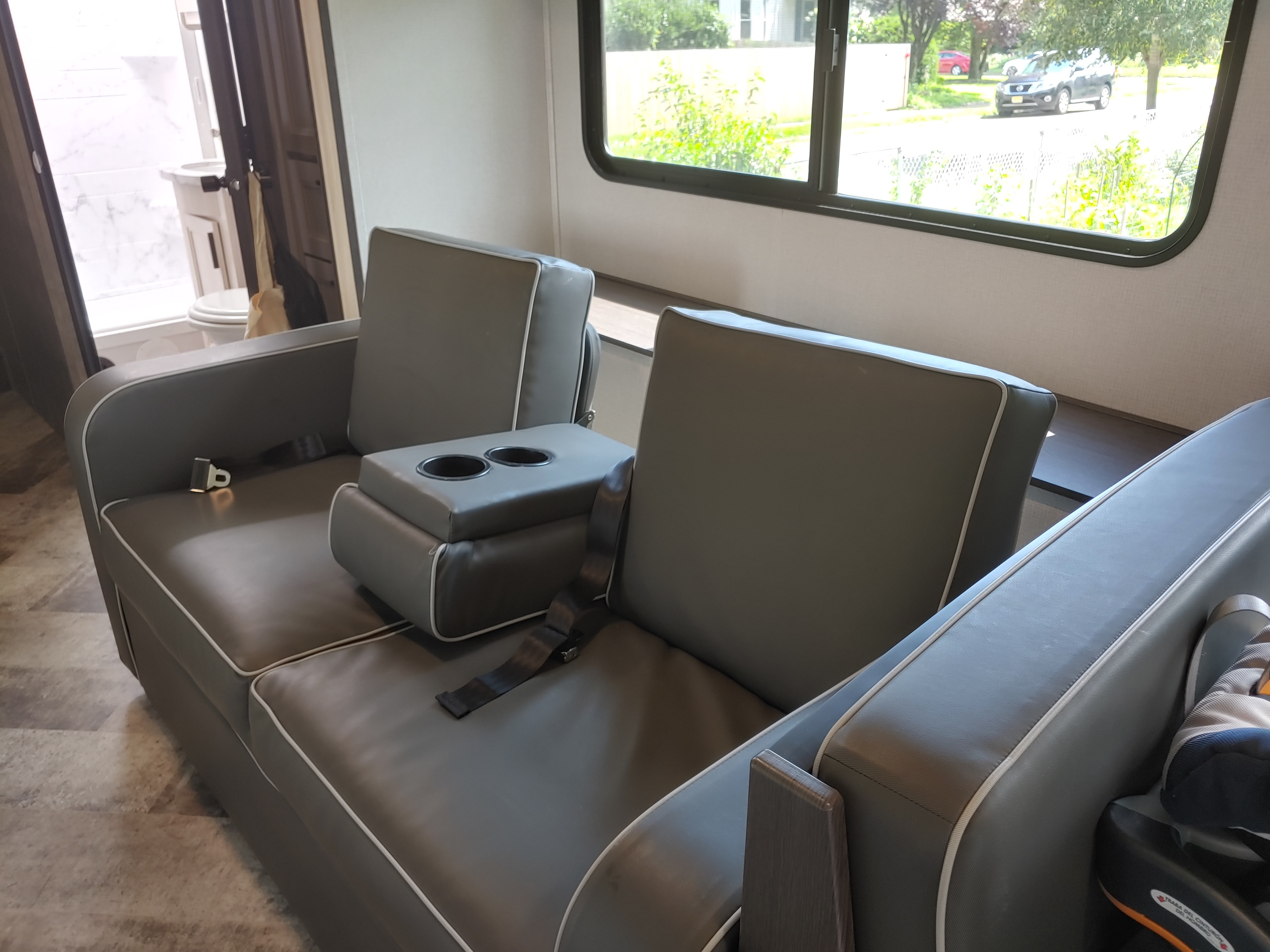 Comfortable sofa has two seat belts for traveling and folds down into a bed.. Forest River Sunseeker 2550DSLE 2020