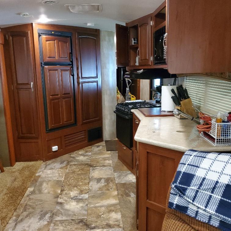 Plenty of counter space and cabinet space. Includes oven/stove, refrigerator. Winnebago Winnebago 2014