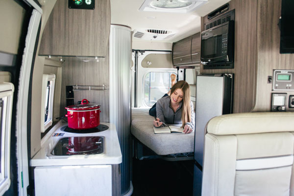 The main bedroom houses a murphy bed that pulls down to sleep two people comfortably.  . Winnebago Travato 2019