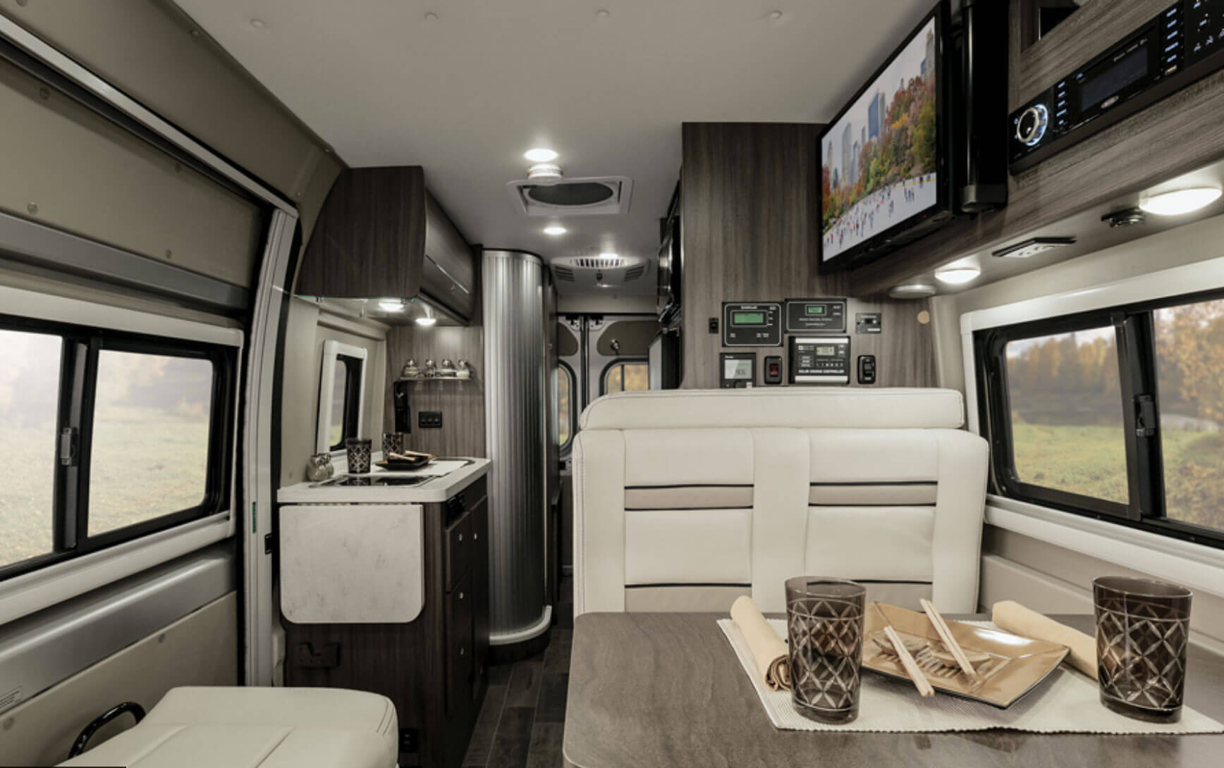 The dinette area is directly behind the drivers seat.  The two lap-style seat belts can accommodates two people and converts to a full bed.. Winnebago Travato 2019