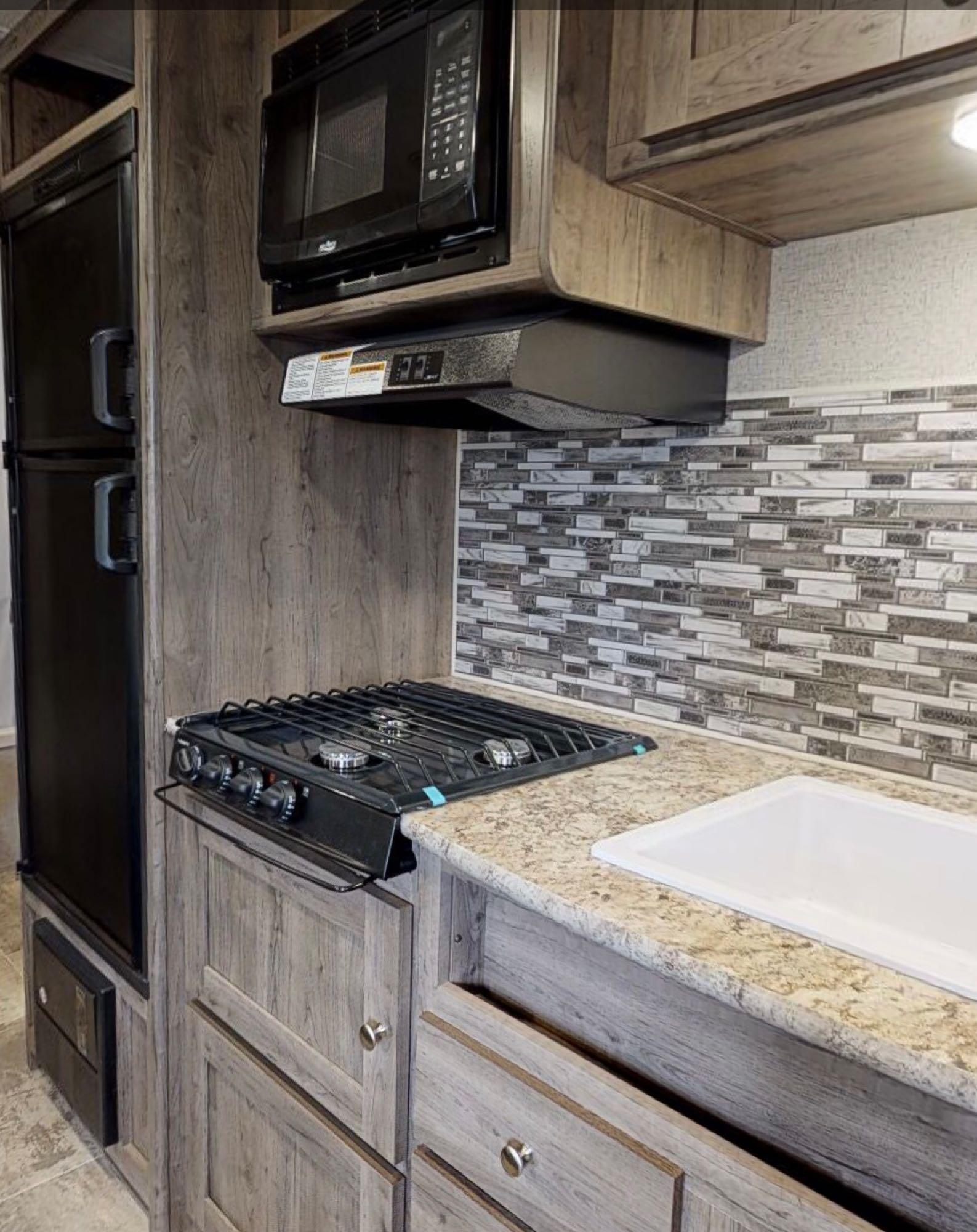 3-range stove, oven, and vent hood. . Dutchmen Aspen Trail 2020