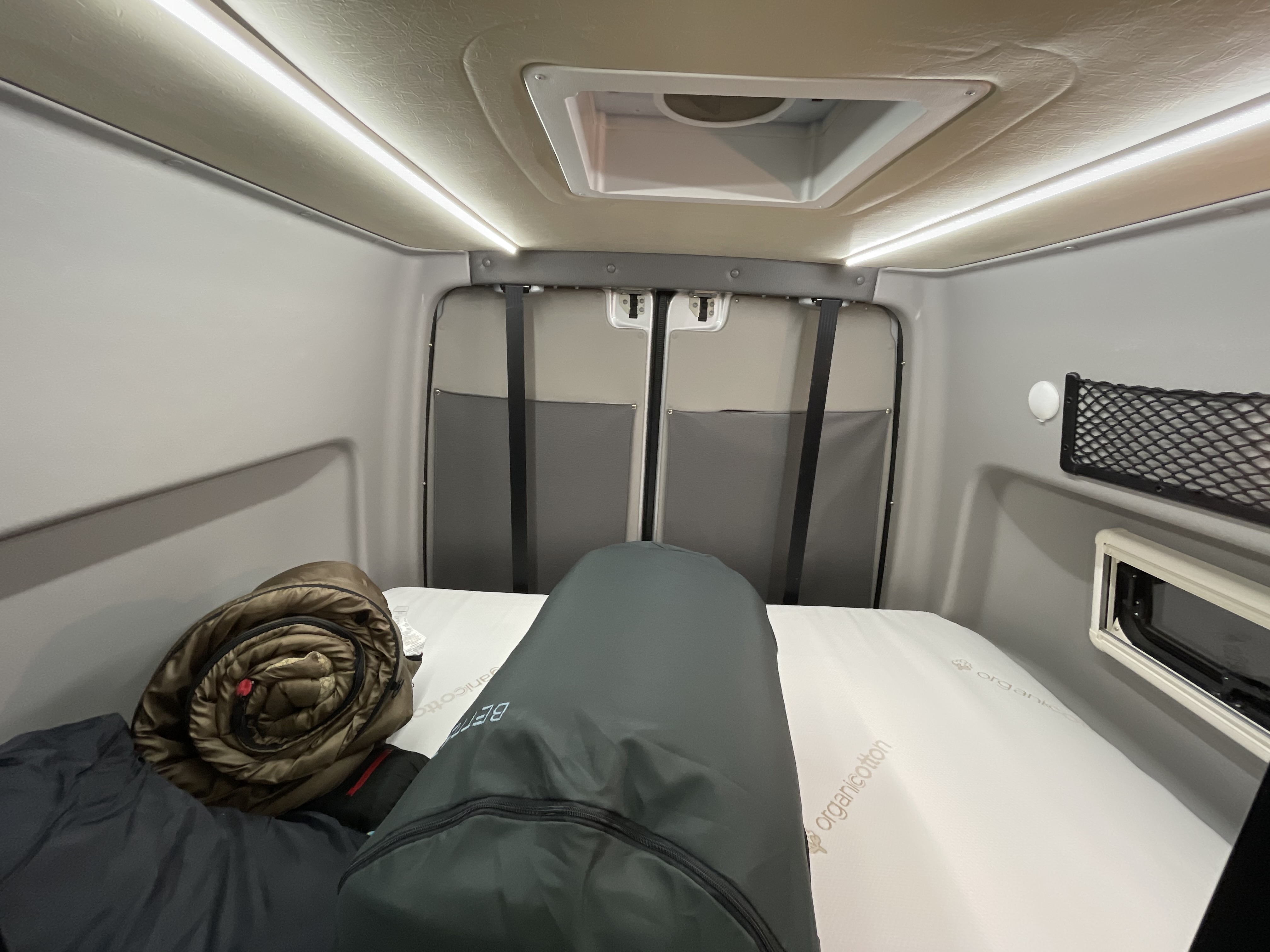The storage area and sleep zone has a bed that lowers down. It's about a Queen size. And with the van's popouts, you get a full length bed.. Winnebago Revel 2018