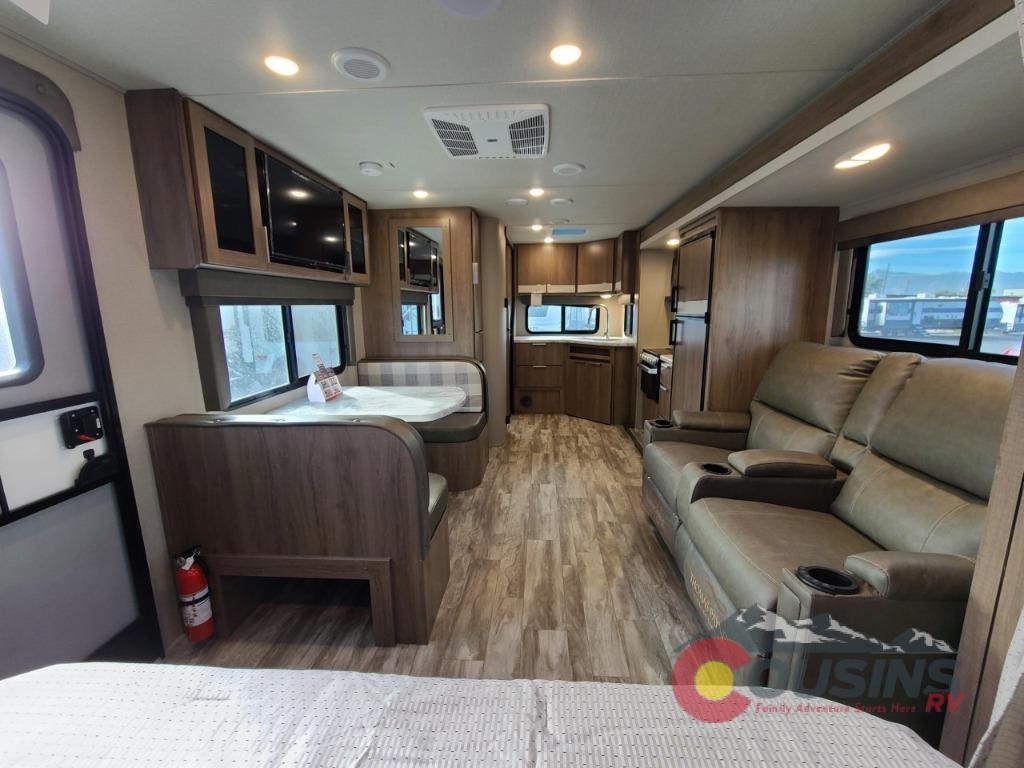 Interior looking toward the back of the camper. Comfy recliners and dinette. . Grand Design Imagine XLS 22 MLE 2021