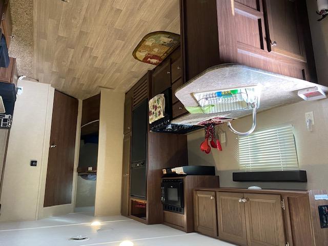Fully stocked roomy kitchen . Dutchmen Coleman 2017