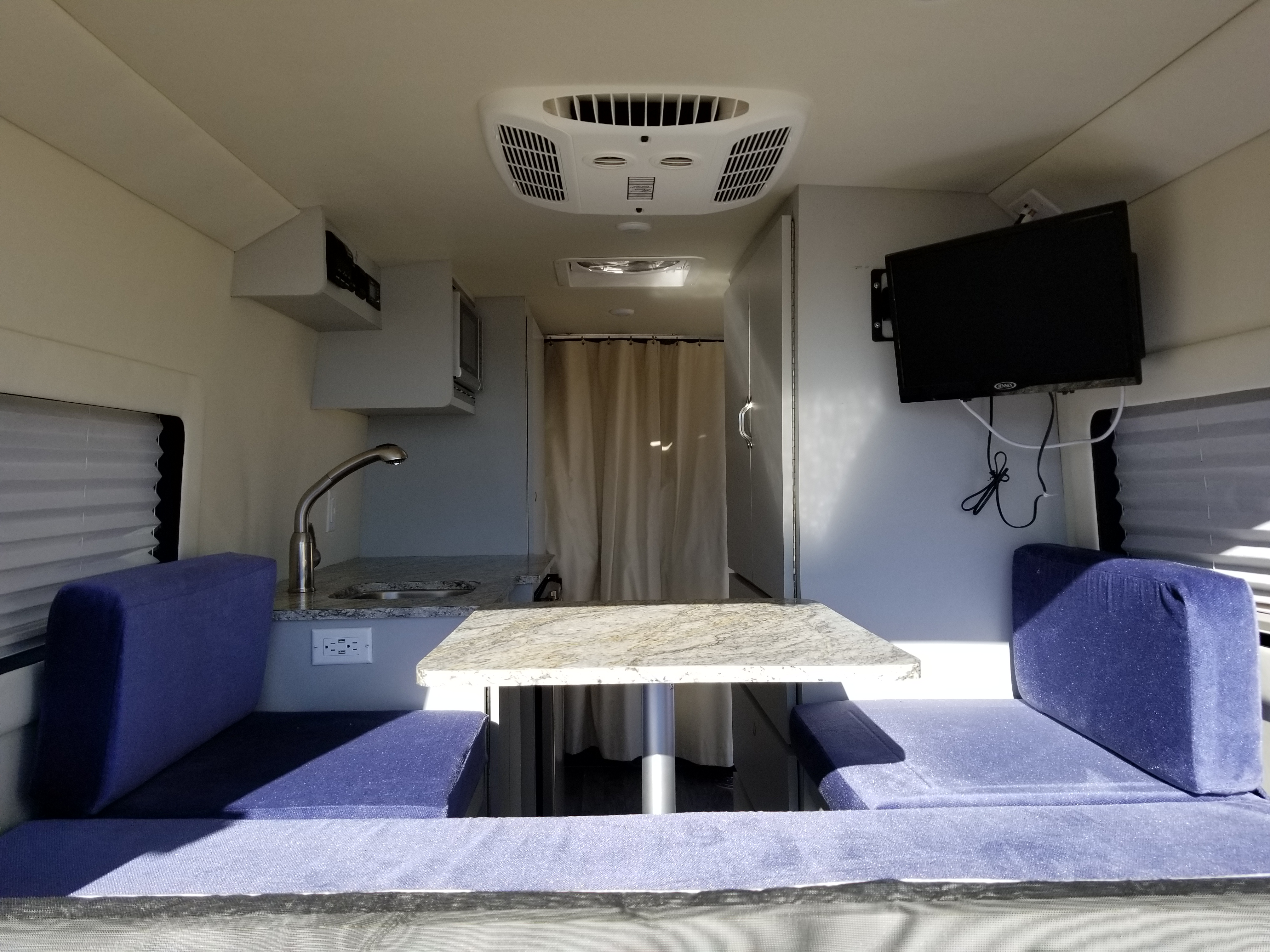 Dinette that can easily changed into a bed seen in next picture. Ford Transit 2018