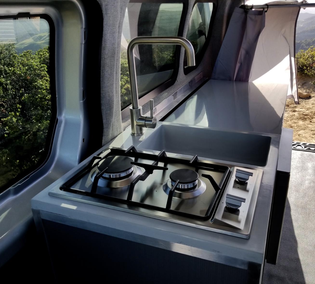 Storage under sink, underside fridge, plenty of counter space, water/25 gal. Ford Transit Custom 2020