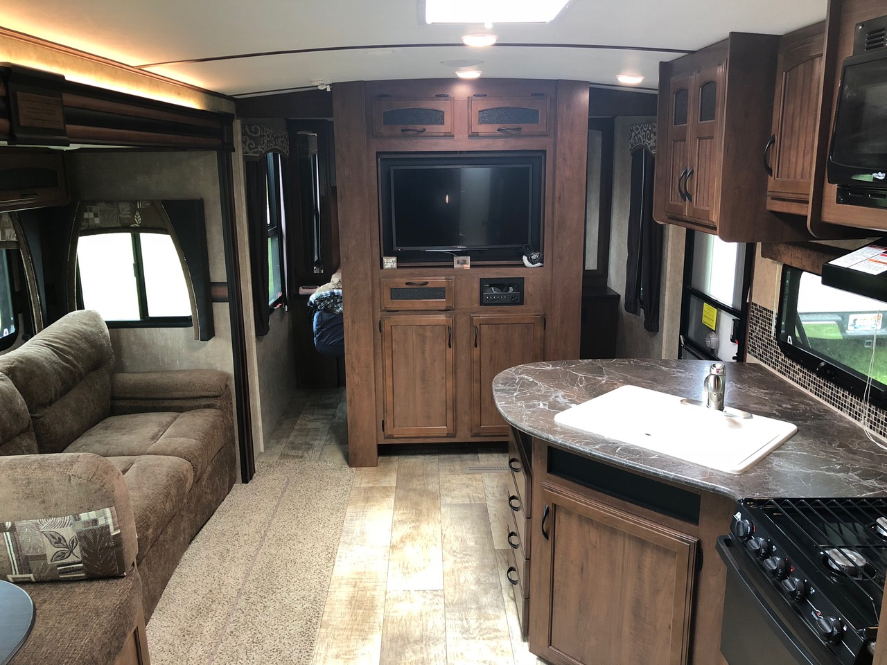 Relax and watch some TV or a movie on the couch. . Jayco White Hawk 2016