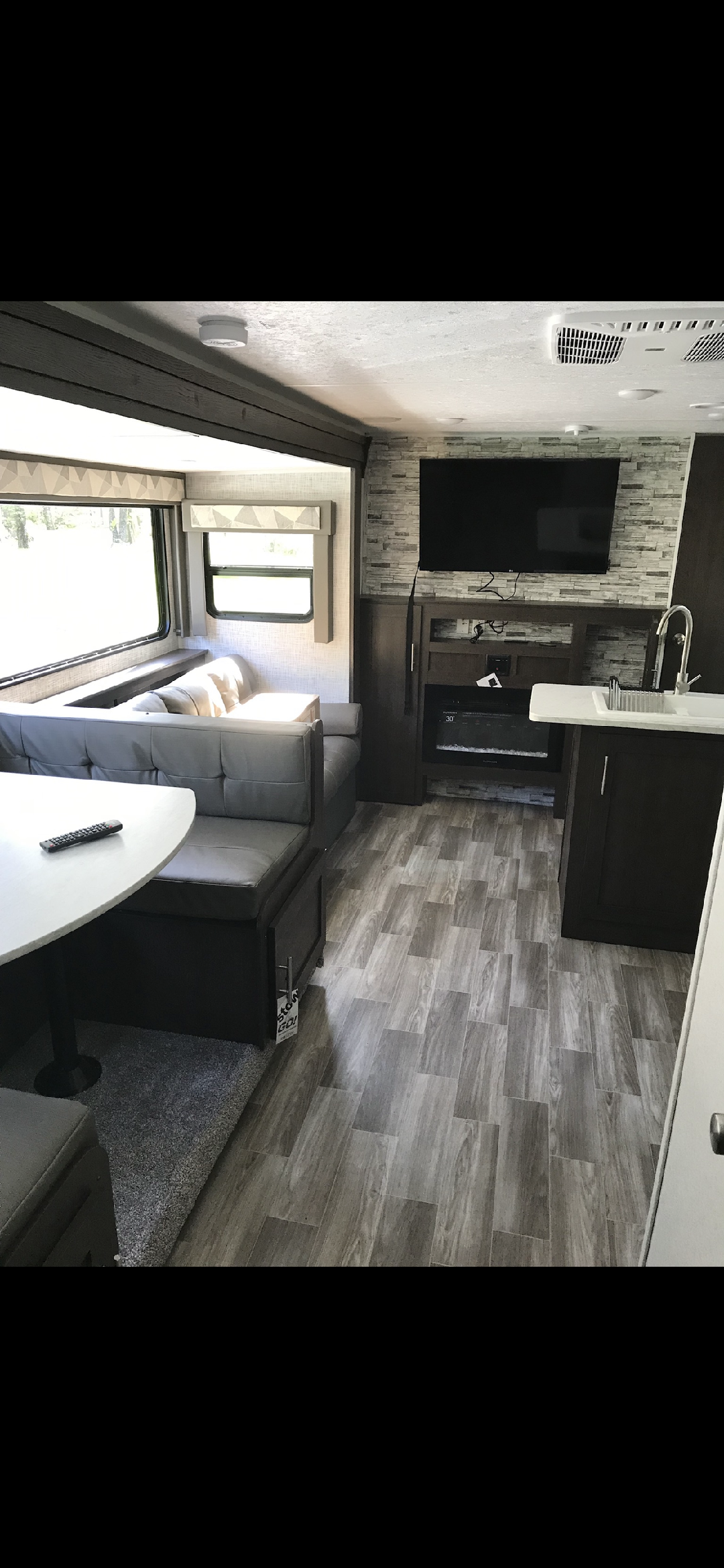 Couch pulls out  and the table folds down to beds (although best for only shorter people :) Gas fireplace for colder weather! TV & VCR for rain! . Forest River Wildwood xlite 2019