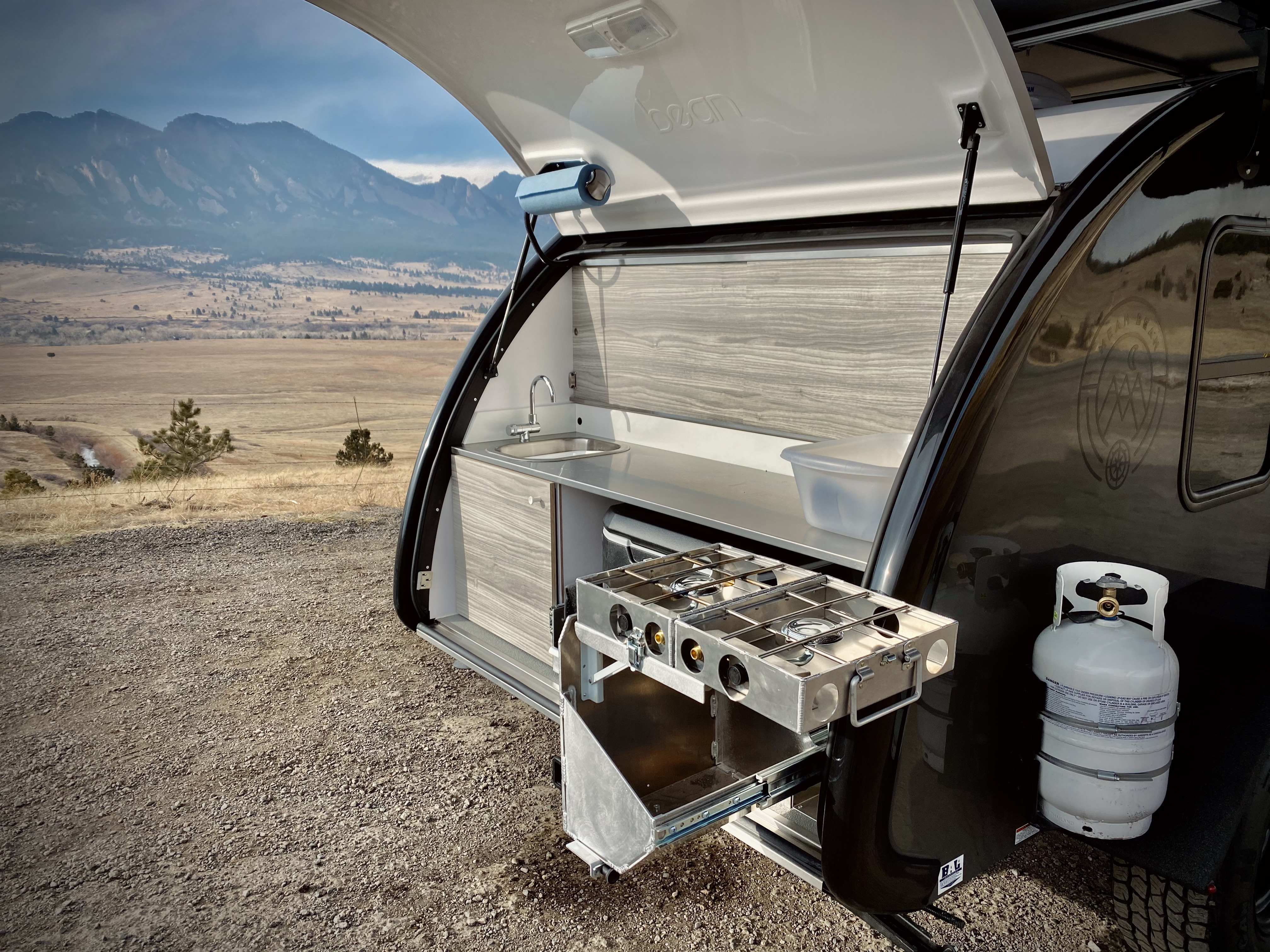 Cooking with Mobi the Mean Bean is a joy.  Stainless steel counter, Camp Partner stove, stainless steel sink with automatic faucet.  And spacious!. Bean Teardrop Trailer Mean Bean 2021