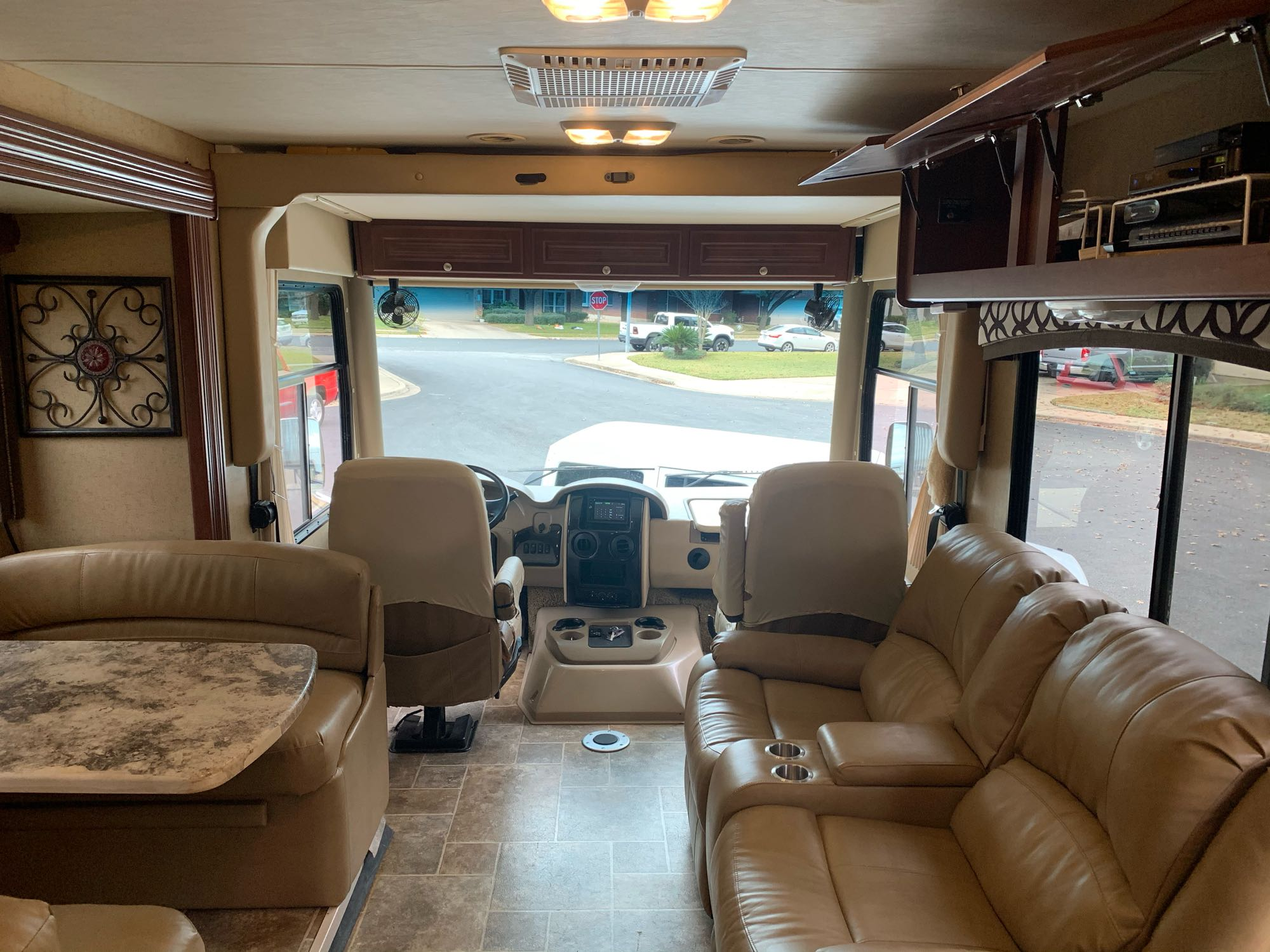 looking toward drivers area. Recliners on right, dinette on left and above cockpit seats is double bed that comes down.. Thor Motor Coach Miramar 34.3 2014