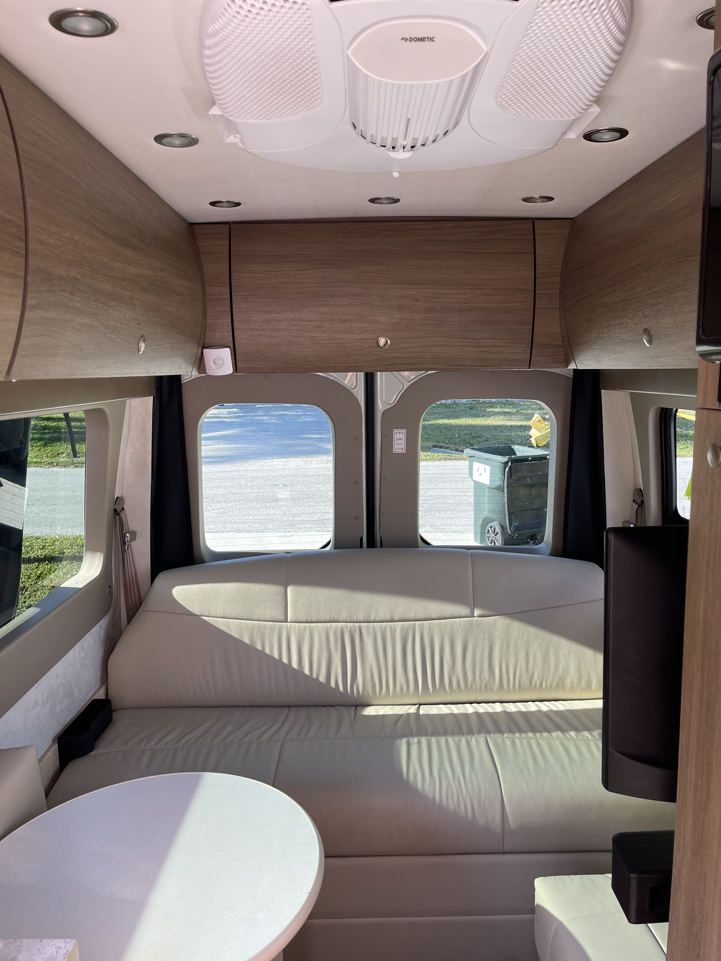 Back comfy memory foam couch area converts to the bed. Two seatbelts and swivel dining table. Overhead storage, small pantry on the right side.. Pleasure Way Ascent 2021