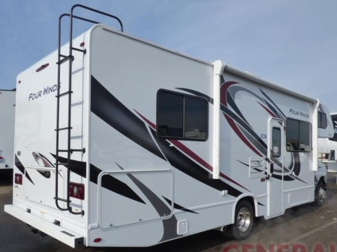 Side view and entrance to a beautiful  motorhome. Electric awning with LED lights.. Thor Four Winds 28A 2021
