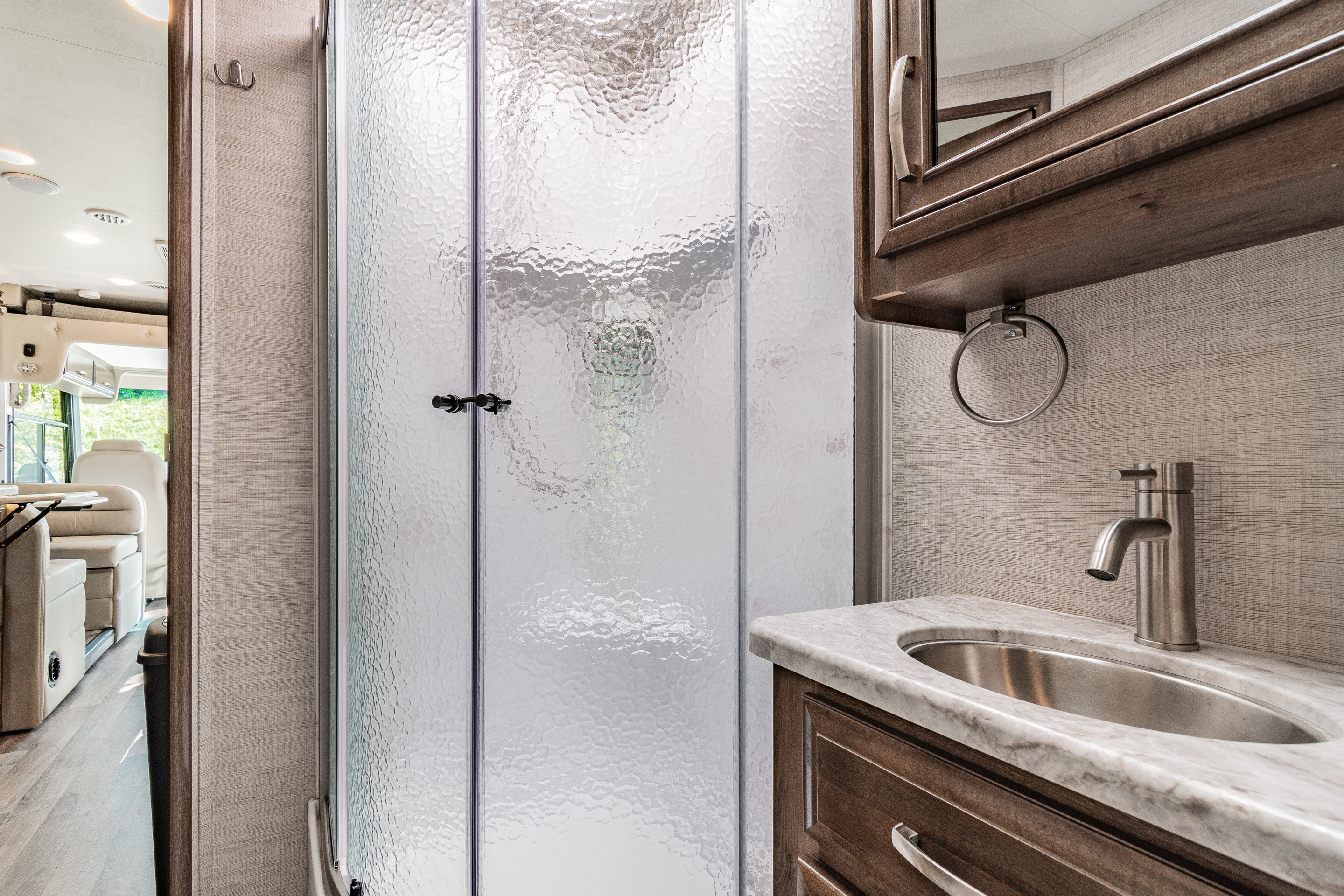 This bathroom has a large stand up shower. Jayco Alante 29F 2021