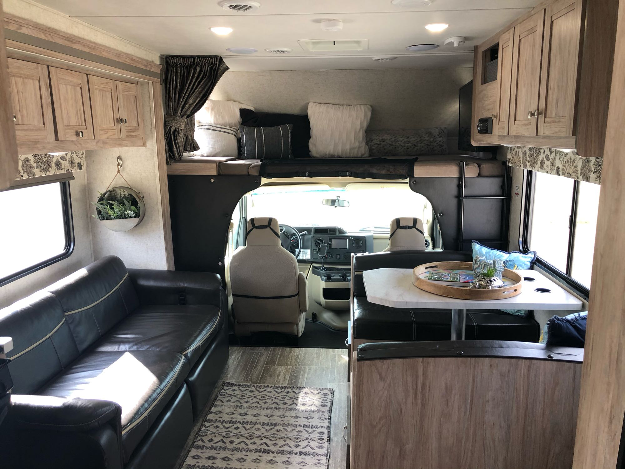 Main area, couch reclines & foldout to double,  dinette table folds down to double and cab bunk has large TV that swings out with DVD & sound system. Forest River Forester 2018