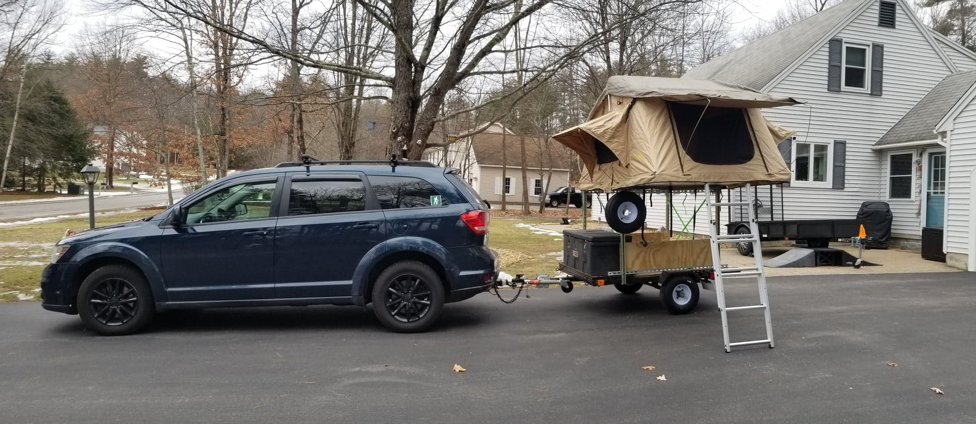 Full set-up behind vehicle (open). Utility Adventure Trailer 2020
