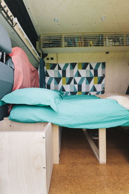 Double bed is created from table area and seats