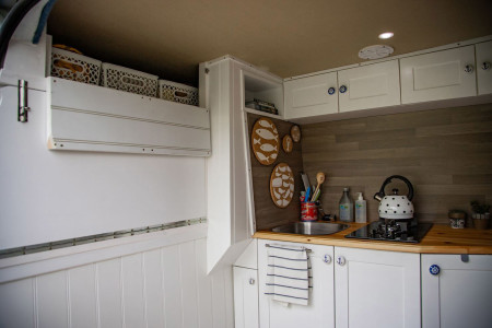 Inside kitchen area showing over cab storage