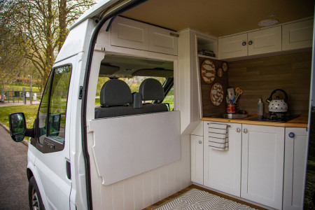 Inside kitchen area with flap down, giving views out to the front of van