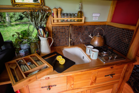 Romas beautifully handcrafted kitchen with gas hob, Belfast sink, running cold water and under counter fridge freezer.