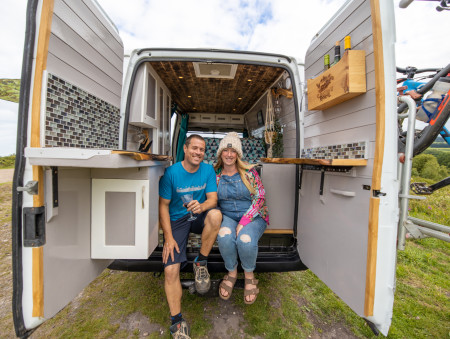 A pic taken from behind the van, looking into the rear doors, with Nick and Leilah (Chat Rad's owners) sat on the floor of the van.