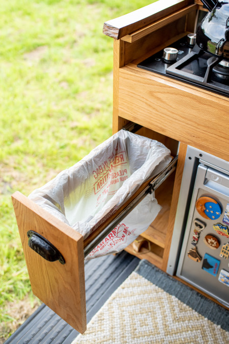 The hidden bin is sized to work with any shopping bag or small bin bag