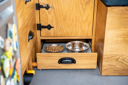 There is even a pull out pet food drawer for the doggo