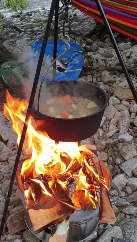 Cooking over the fire while the hammocks await
